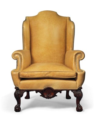 A LARGE MAHOGANY WING ARMCHAIR