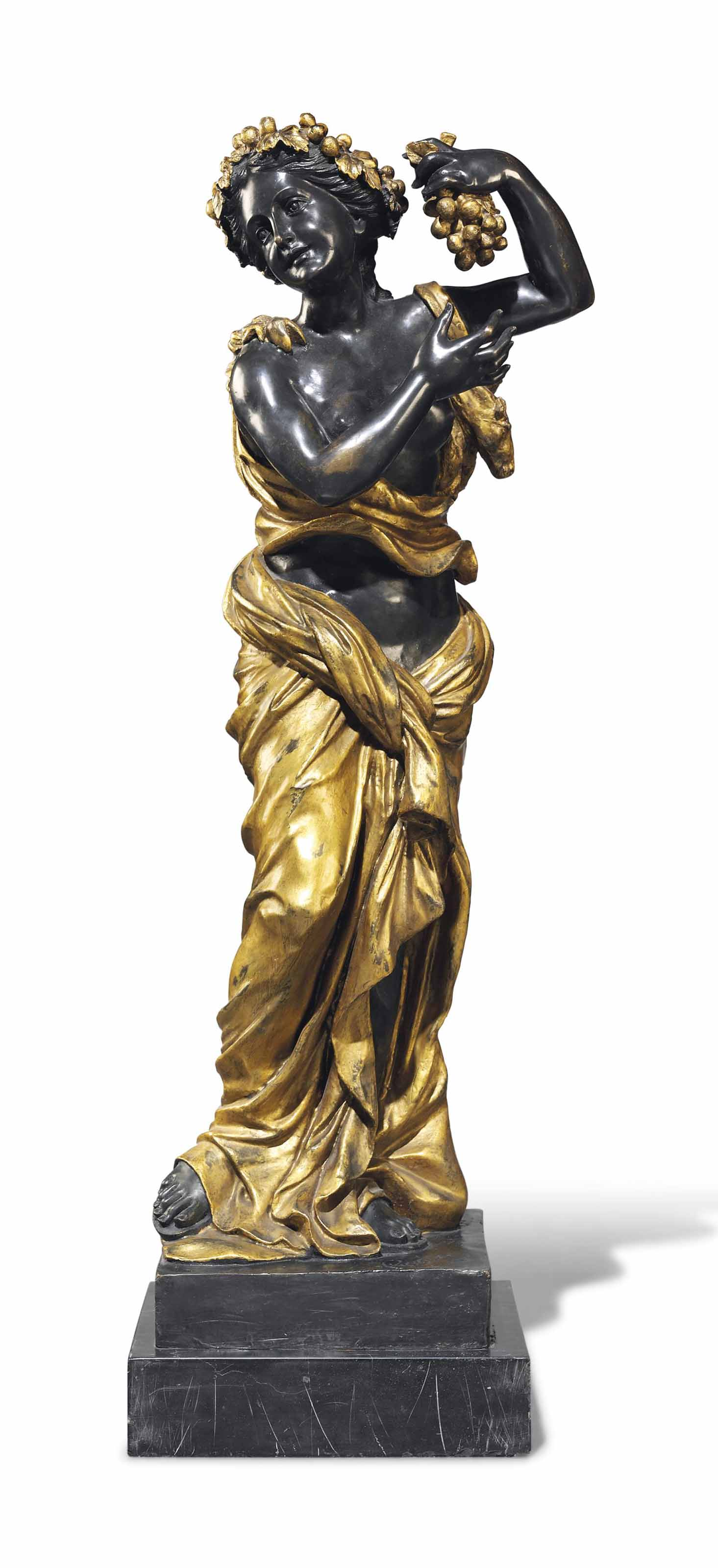 A BRONZE AND GILT DECORATED FIGURE OF A BACCHANTE