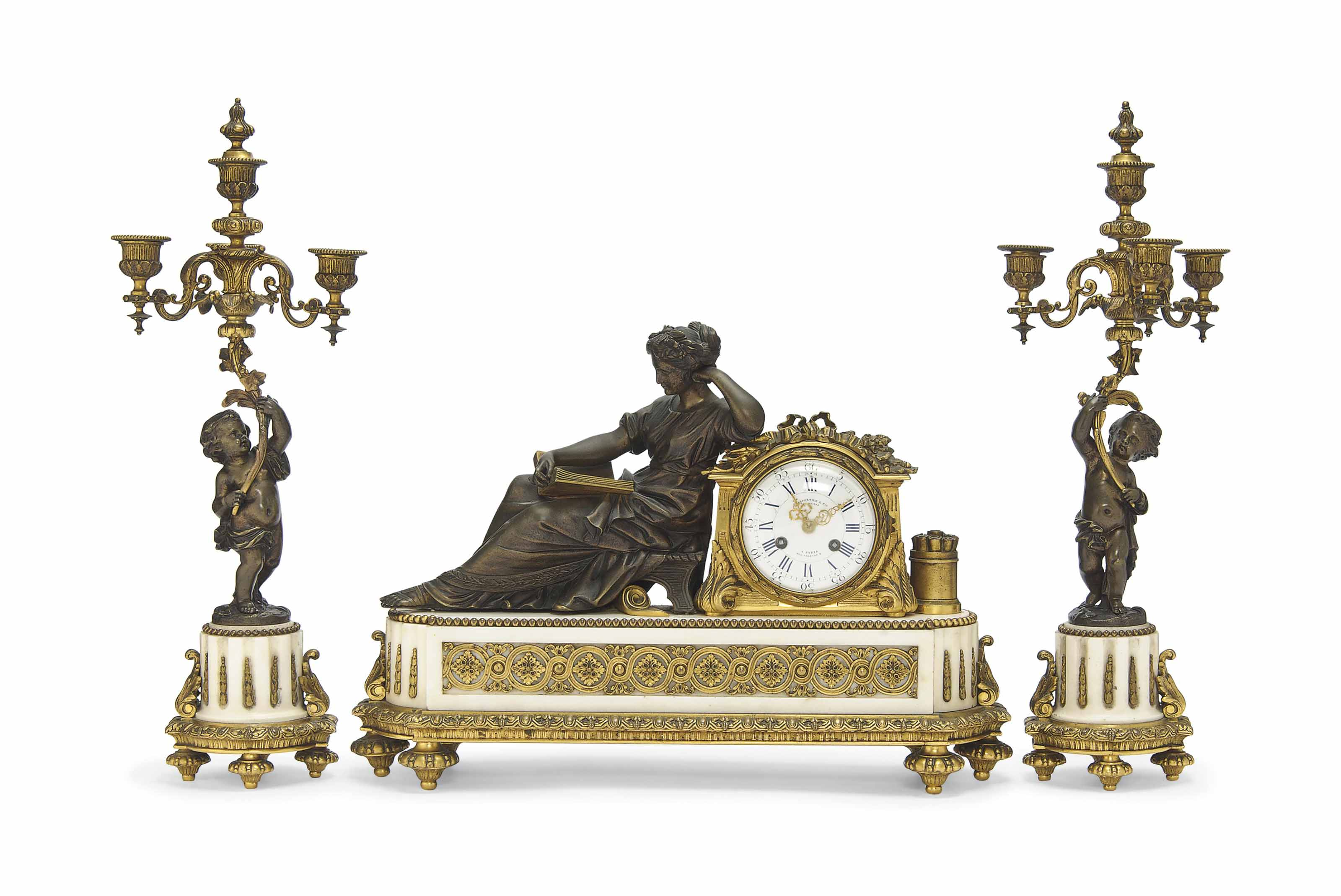 A NAPOLEON III GILT AND PATINATED BRONZE AND MARBLE CLOCK GARNITURE