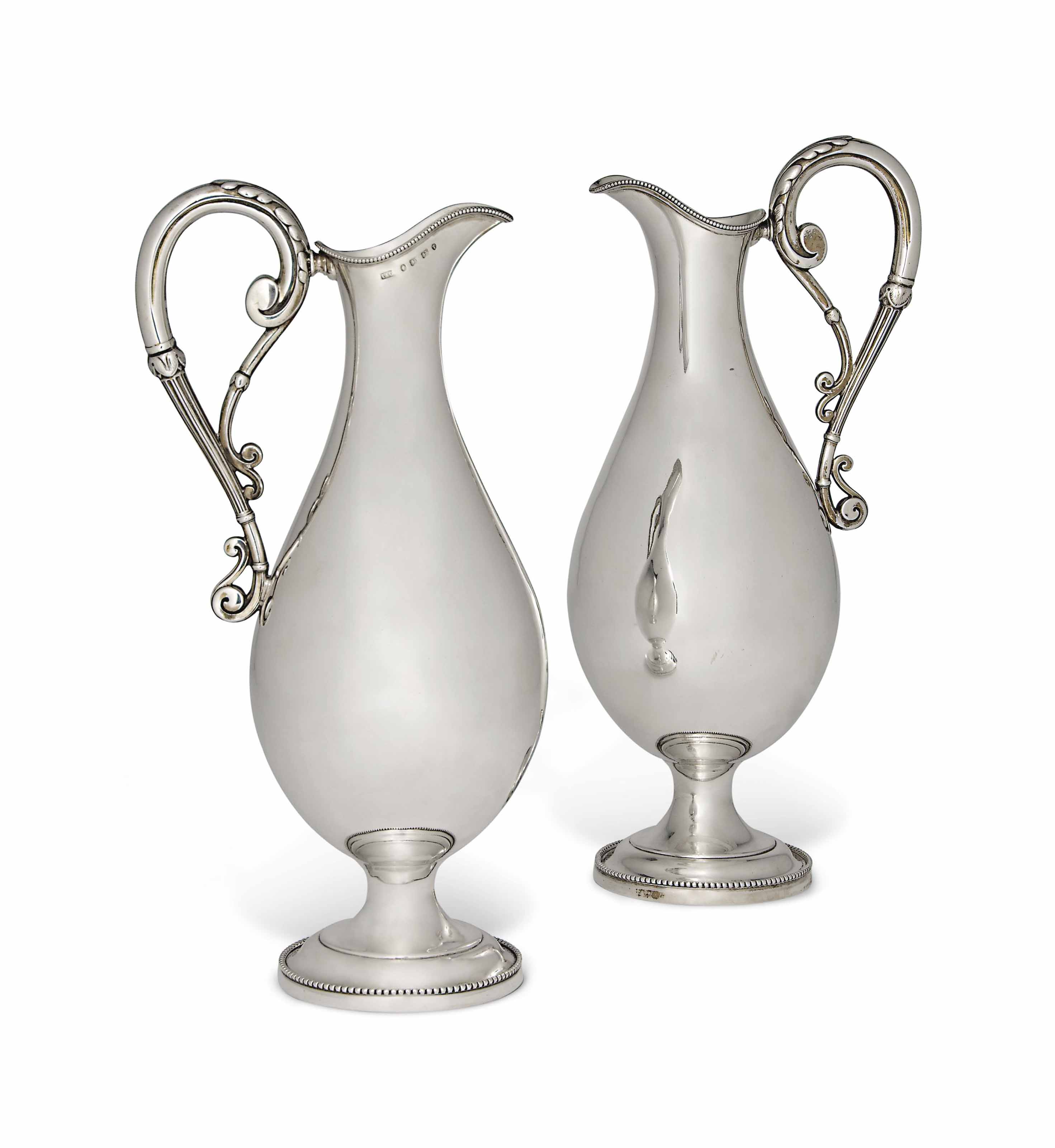 A MATCHED PAIR OF VICTORIAN SILVER CLARET JUGS