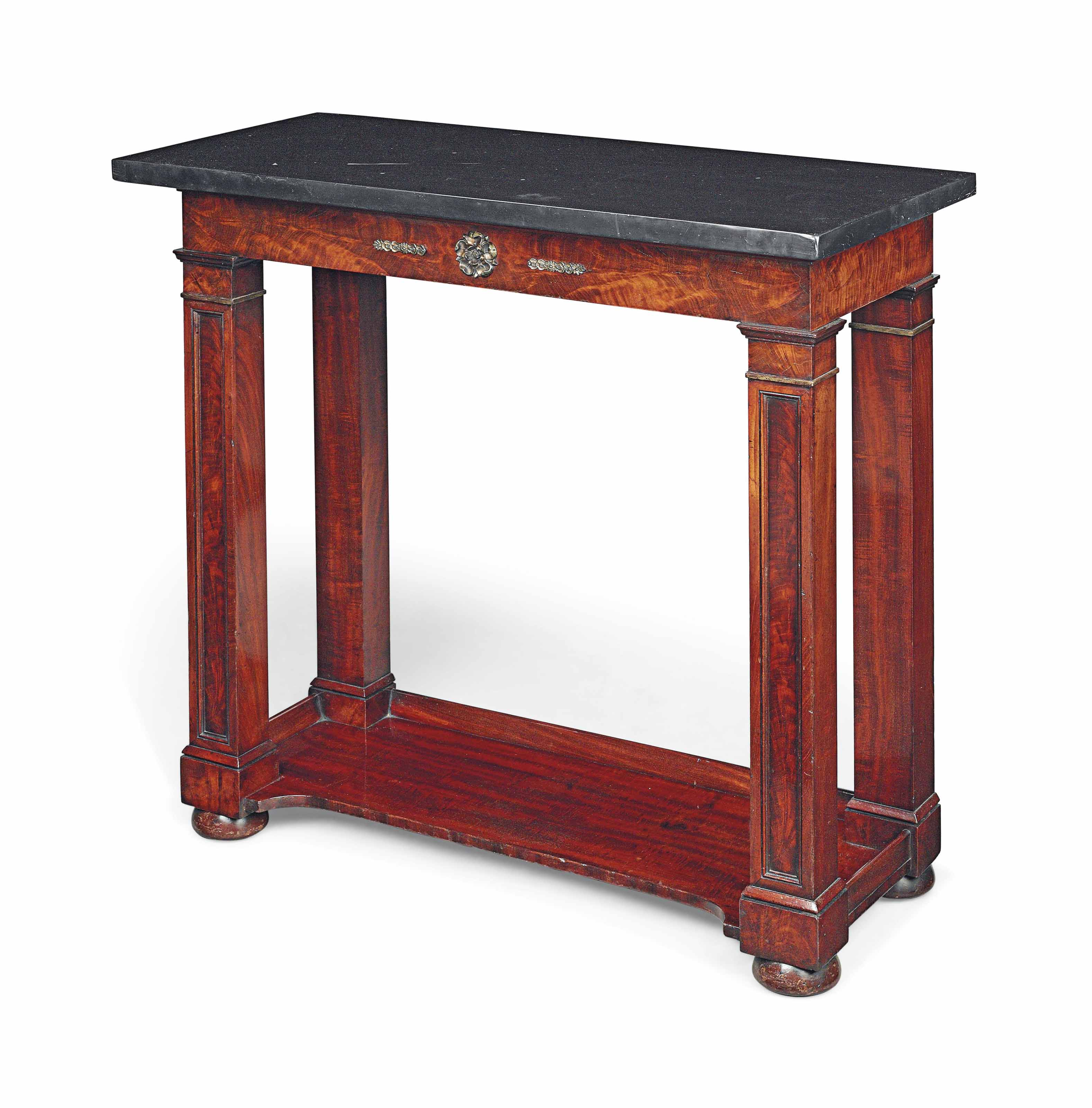 A REGENCY GILT-METAL MOUNTED AND PARCEL-GILT MAHOGANY CONSOLE TABLE
