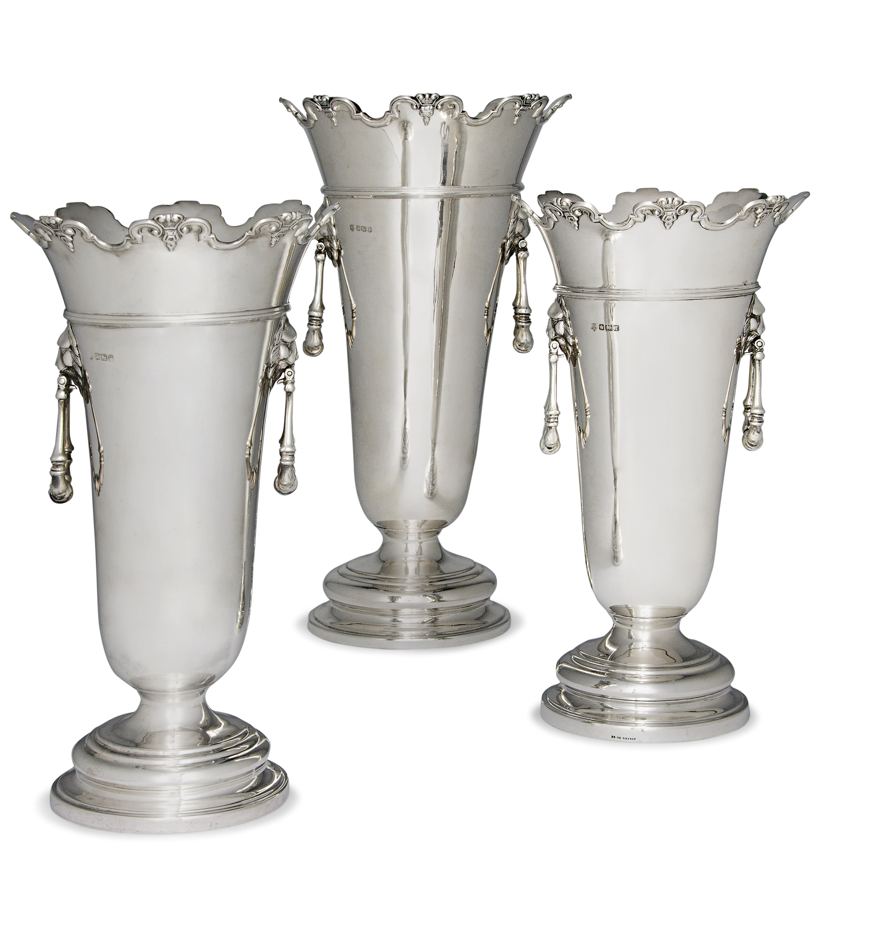 A MATCHED SET OF THREE SILVER VASES
