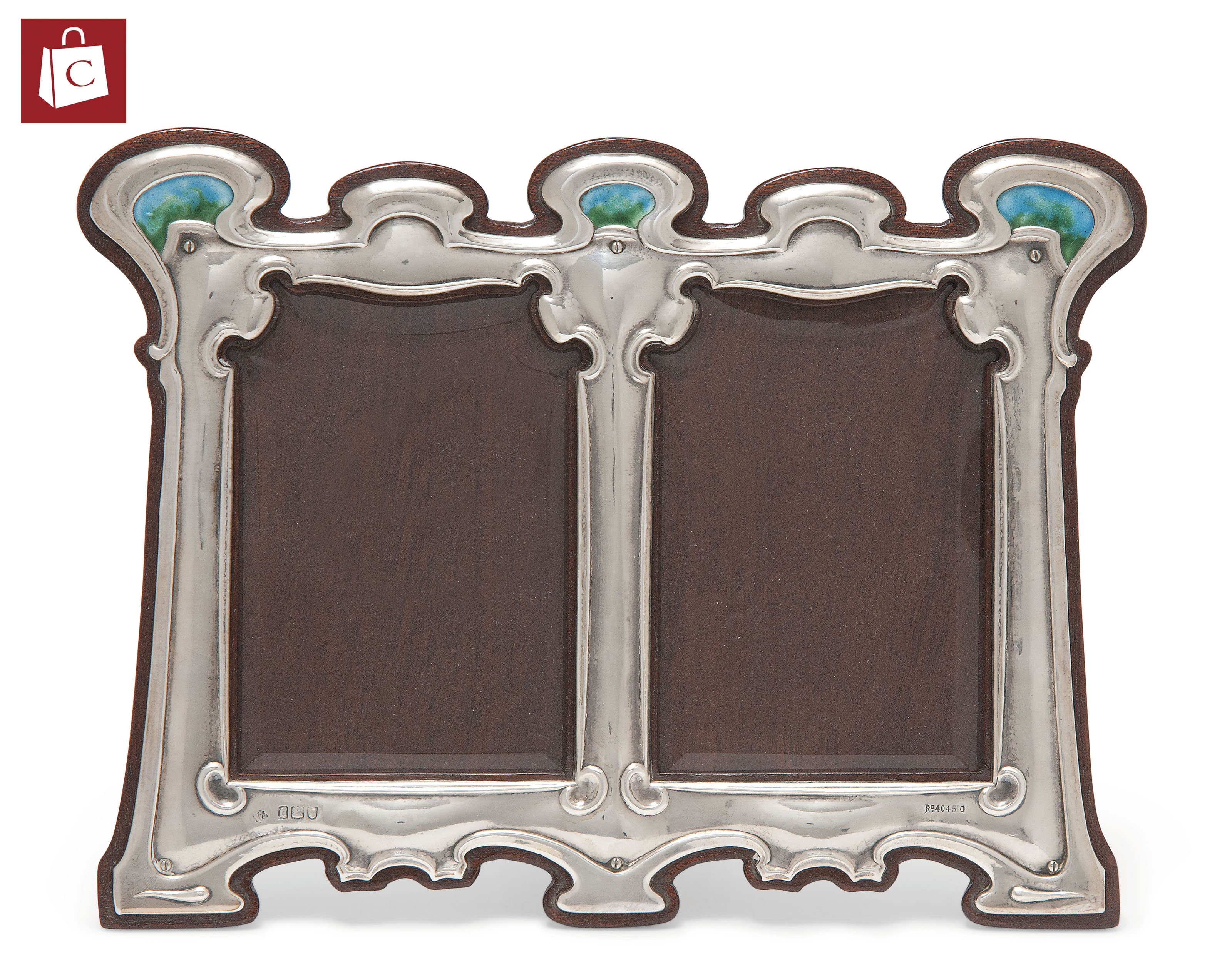 AN ARTS & CRAFTS SILVER, ENAMEL AND MAHOGANY DOUBLE PHOTOGRAPH FRAME