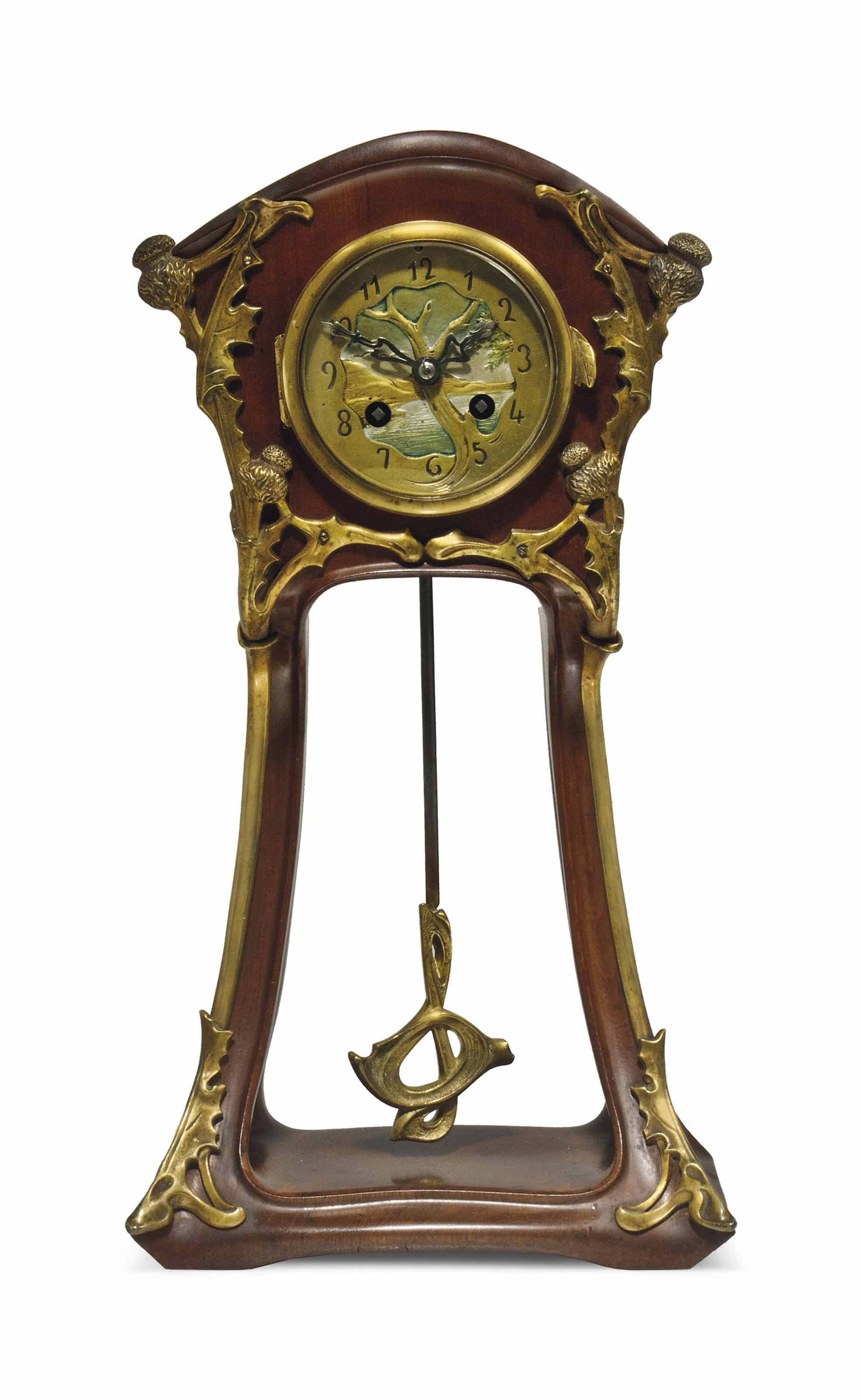 A LOUIS MAJORELLE (1859-1926) ART NOUVEAU WALNUT AND GILT BRONZE MANTEL CLOCK