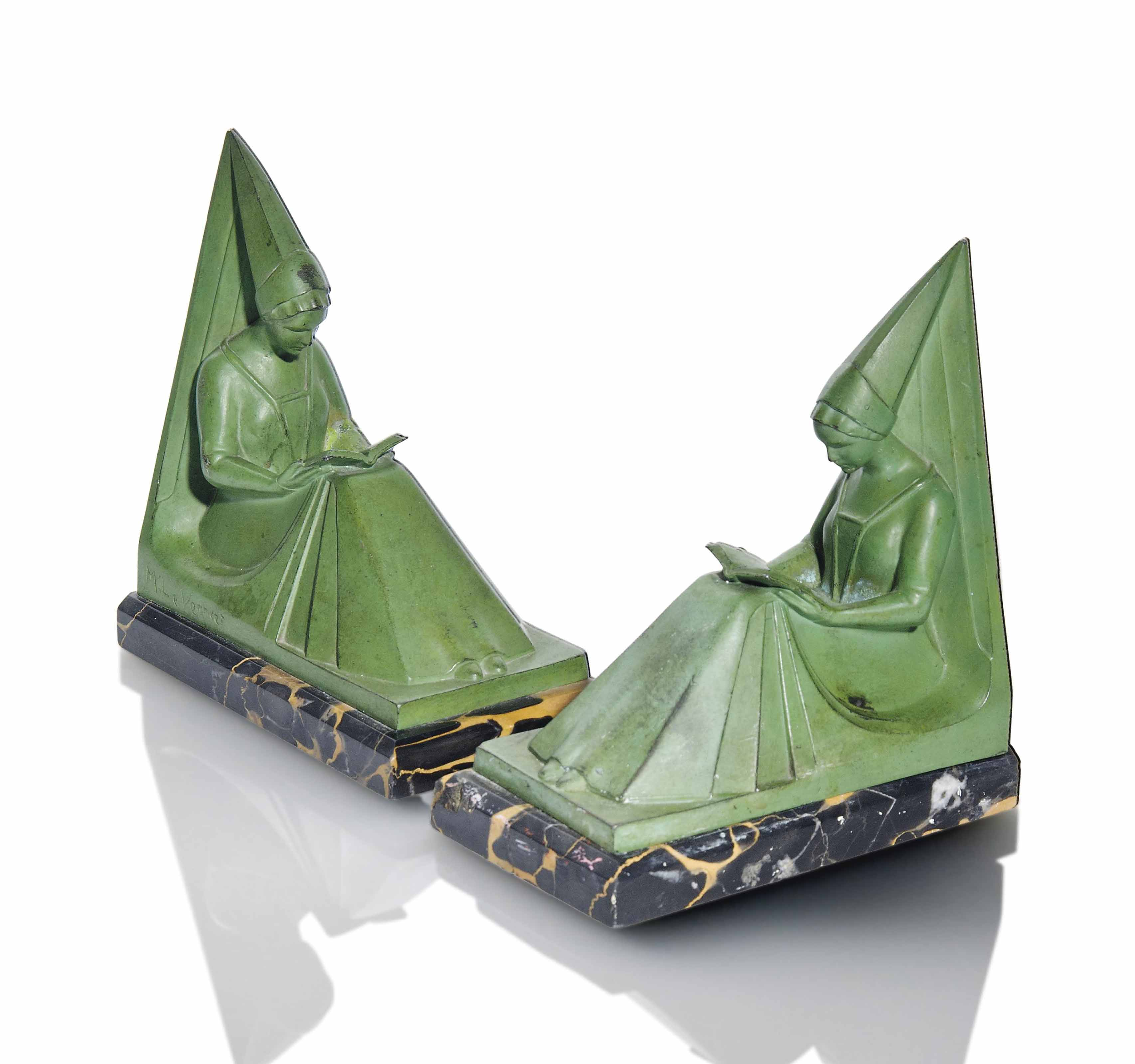 A PAIR OF MAX LE VERRIER (1891-1973) COLD-PAINTED SPELTER BOOKENDS