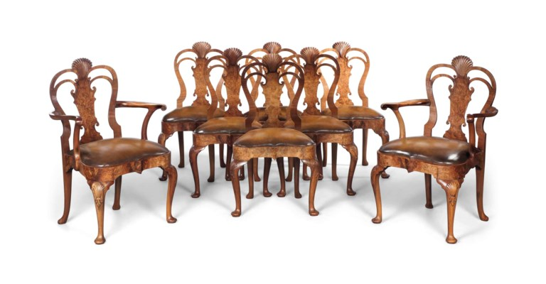 A SET OF EIGHT WALNUT AND BURR