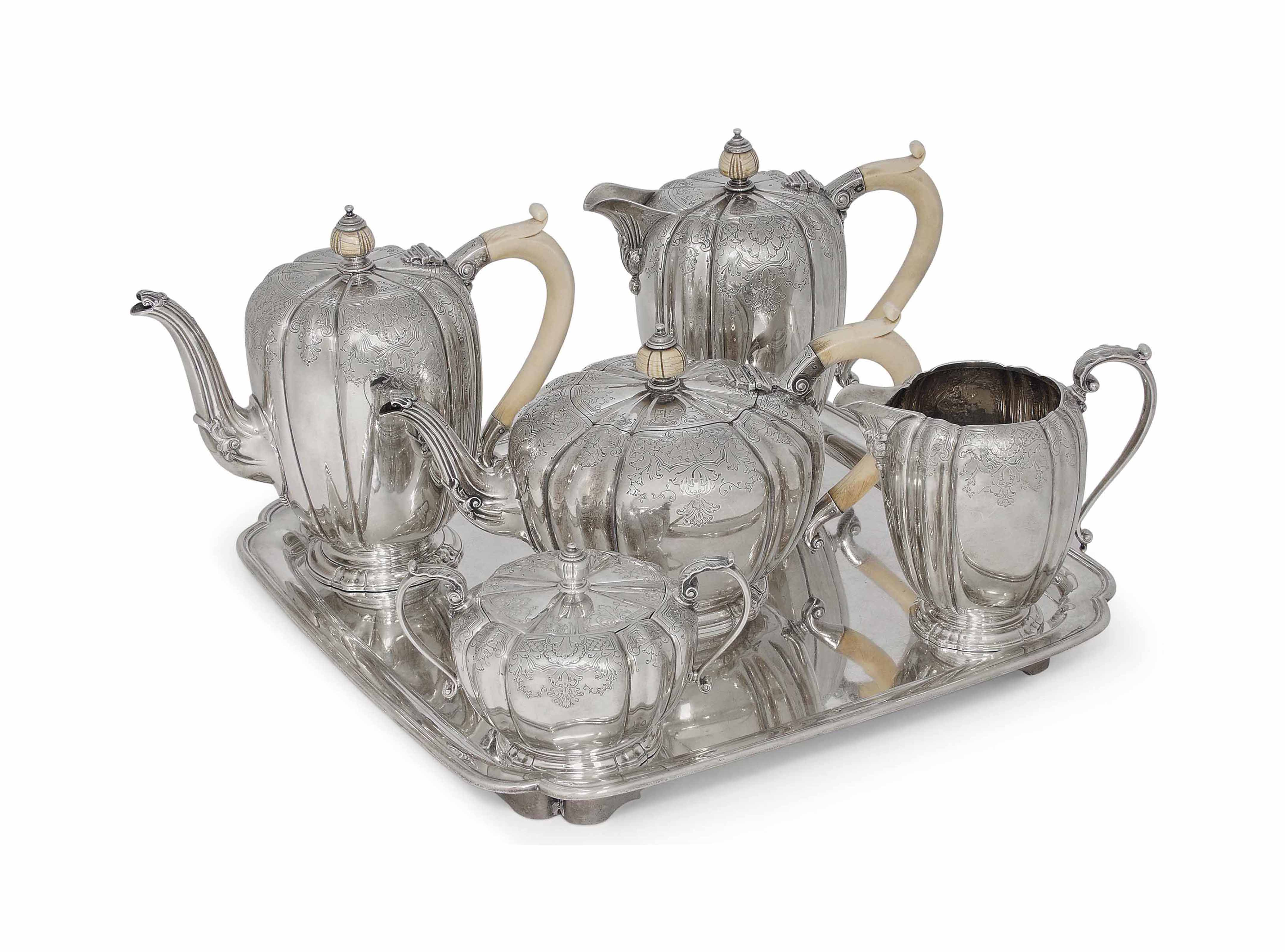 A FOUR -PIECE SILVER TEA AND COFFEE SET WITH IVORY HANDLES AND FINIALS AND A LATER COVERED SUGAR BOWL EN SUITE, TOGETHER WITH AN ASSOCIATED SHAPED SQUARE SALVER