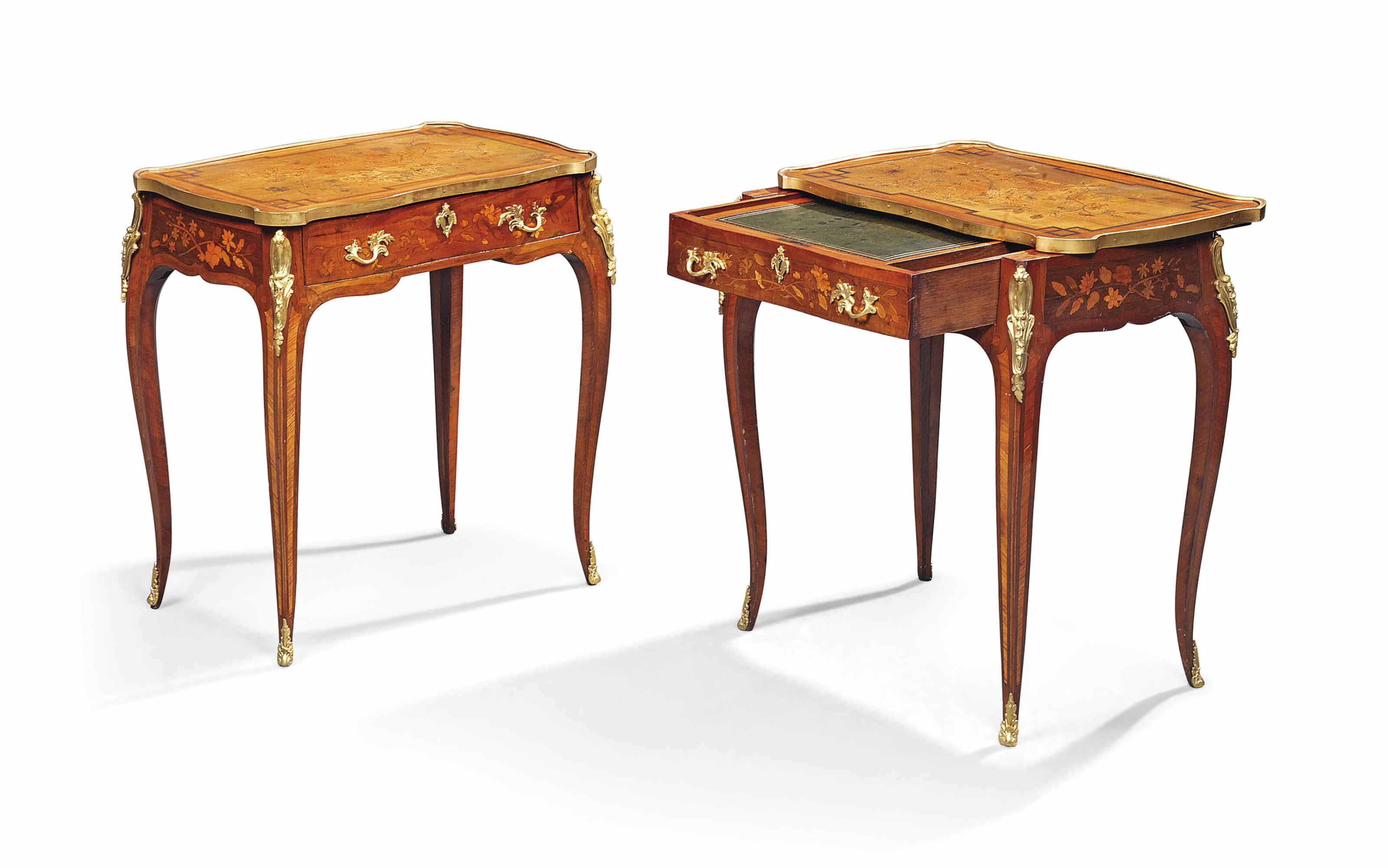 A NEAR PAIR OF ORMOLU-MOUNTED PADOUK, HAREWOOD AND MARQUETRY WRITING TABLES