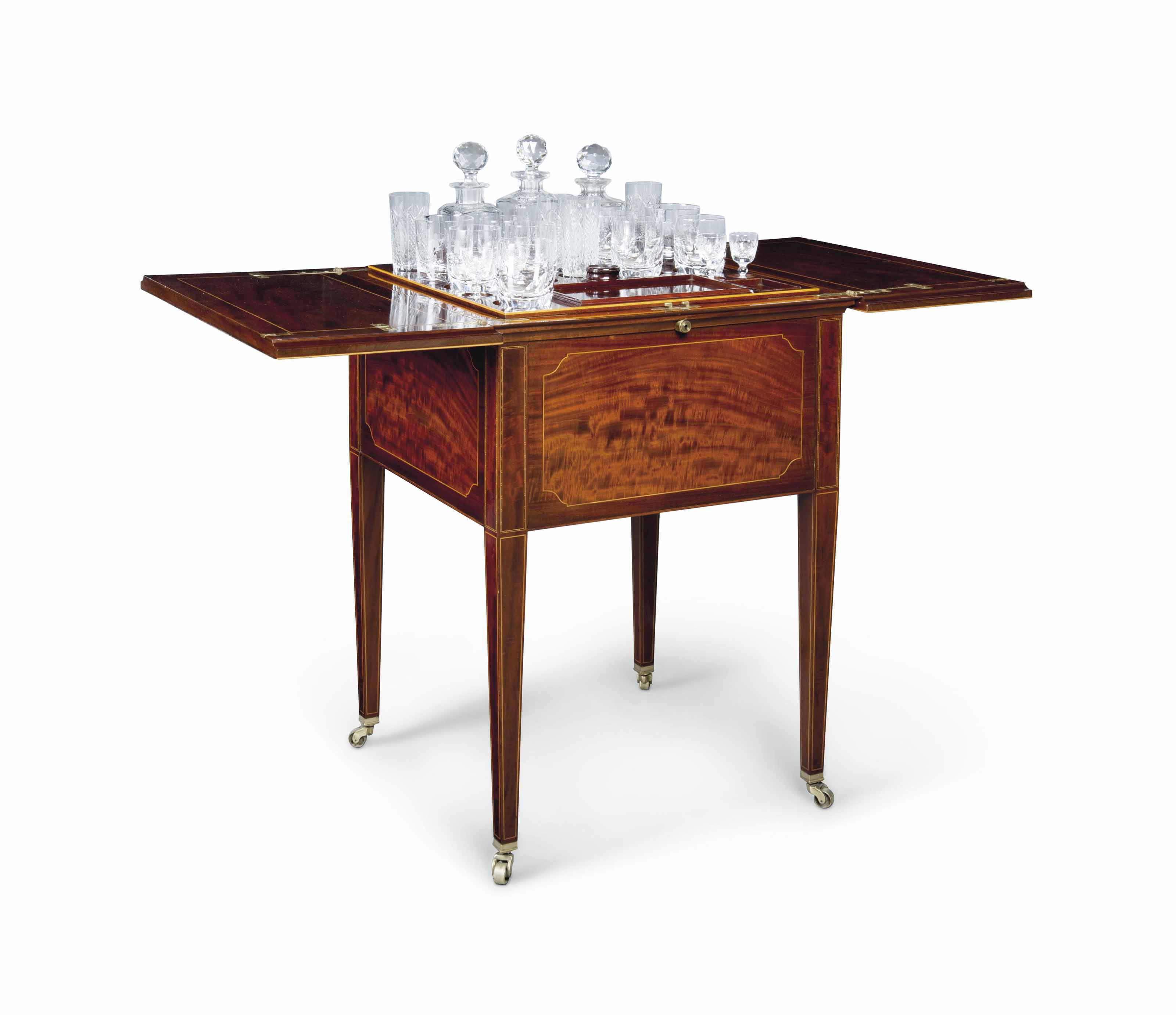 AN EDWARDIAN FIGURED MAHOGANY AND CHEQUER-STRUNG DRINKS SERVING CABINET