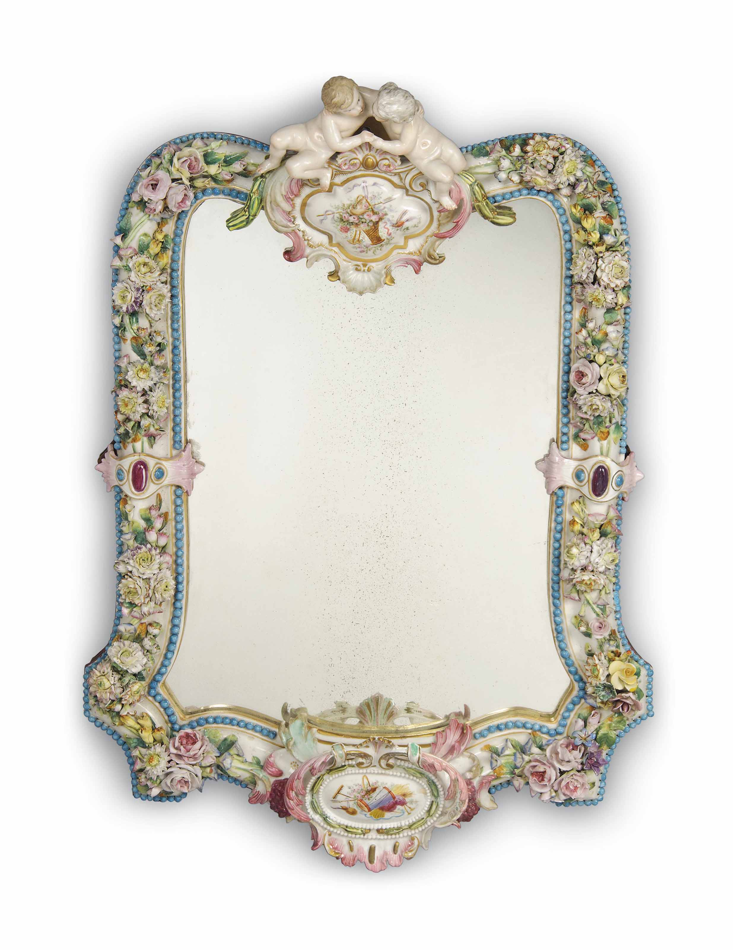 A GERMAN PORCELAIN FLOWER-ENCRUSTED MIRROR FRAME