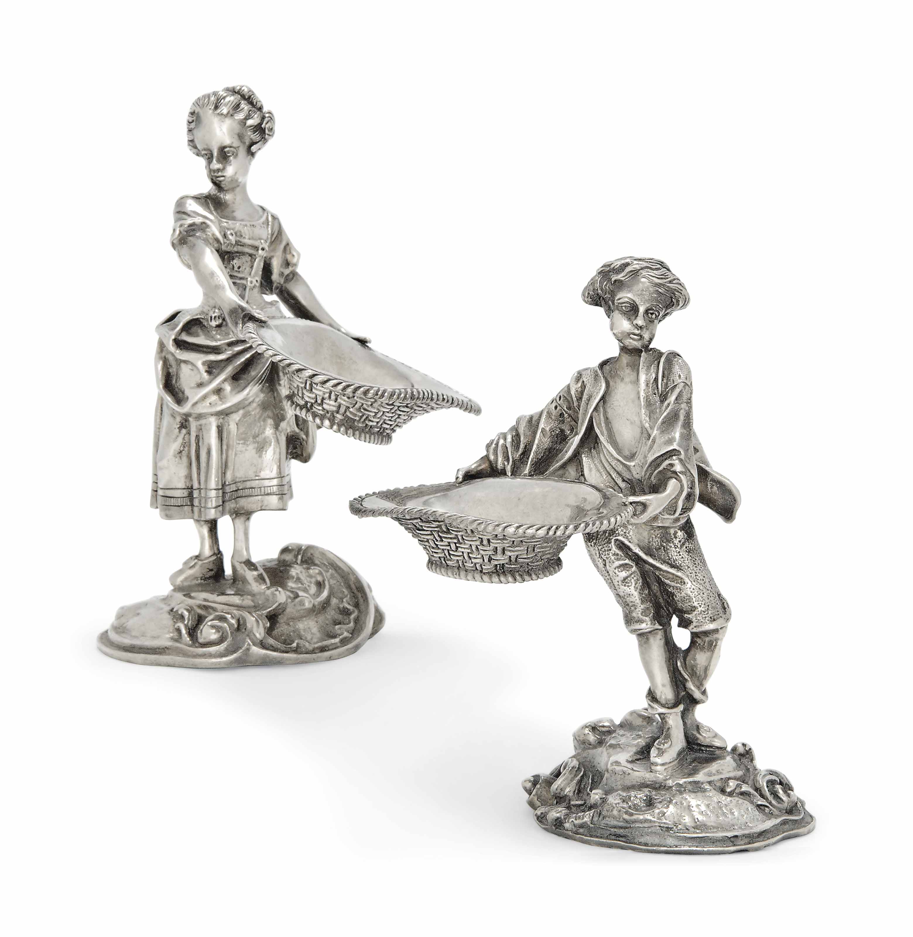 A PAIR OF LATE VICTORIAN SCOTTISH CAST SILVER FIGURAL SALTS