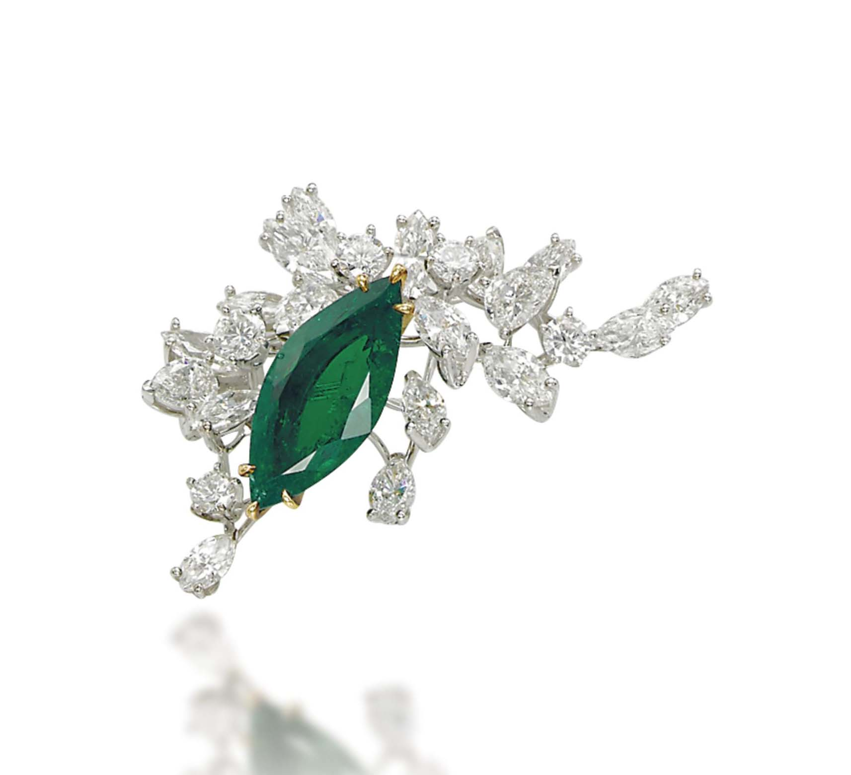 AN EMERALD AND DIAMOND BROOCH, BY MEISTER