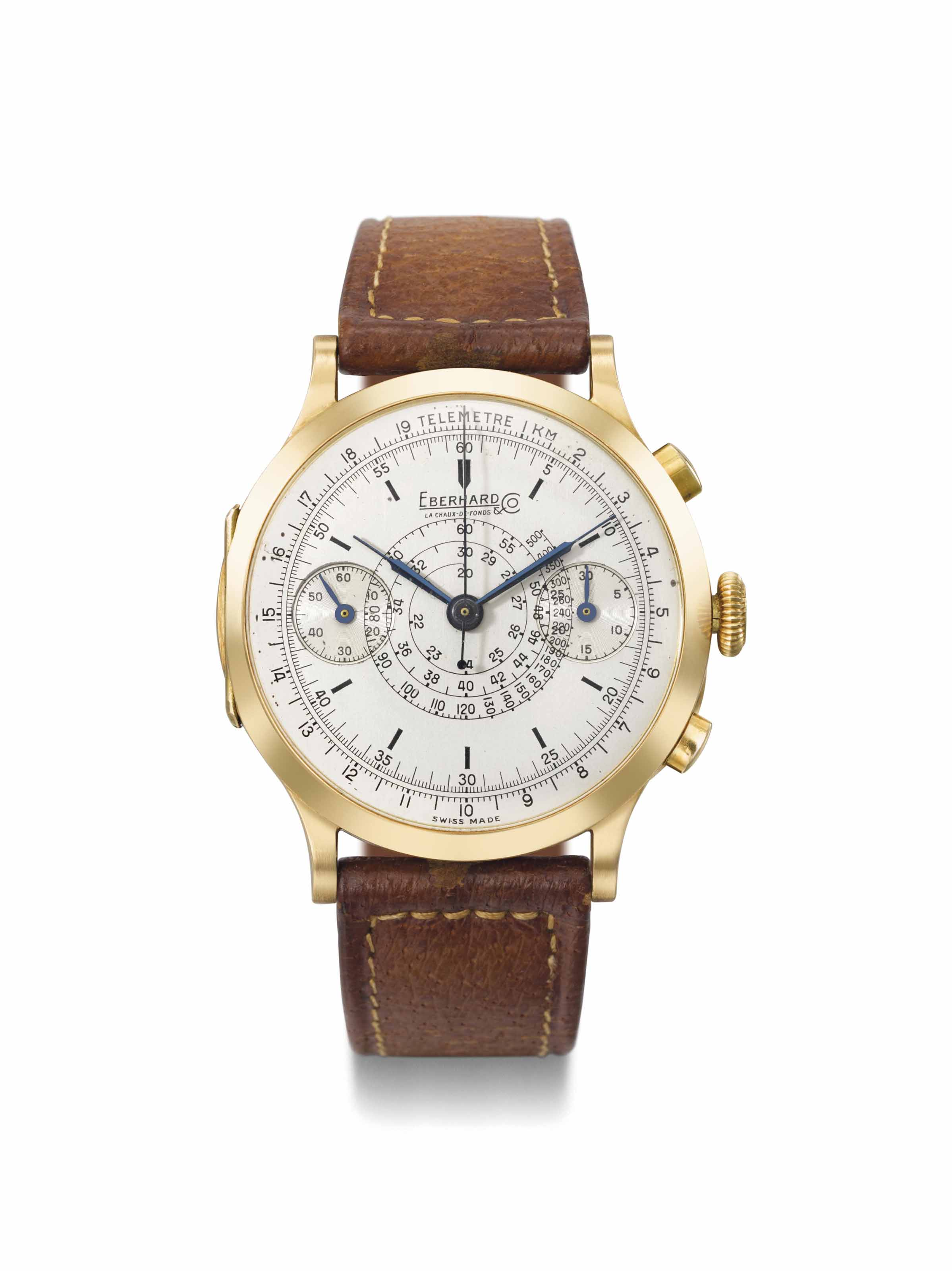Eberhard. A large and attractive 18K gold hinged chronograph wristwatch with two-tone silvered dial and patented split time mechanism