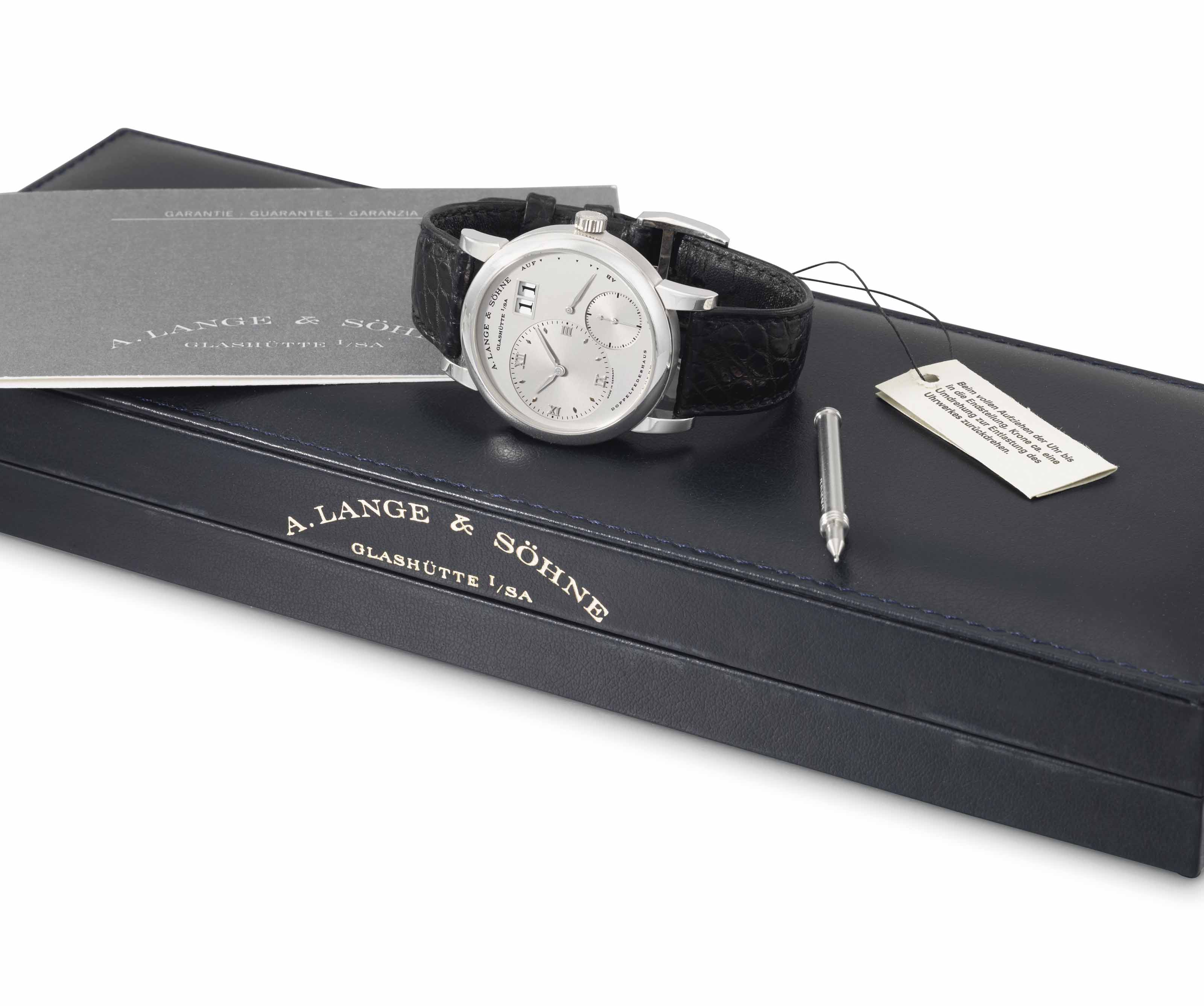 A. Lange & Söhne. A fine platinum twin barrel wristwatch with oversized date, power reserve, certificate and box
