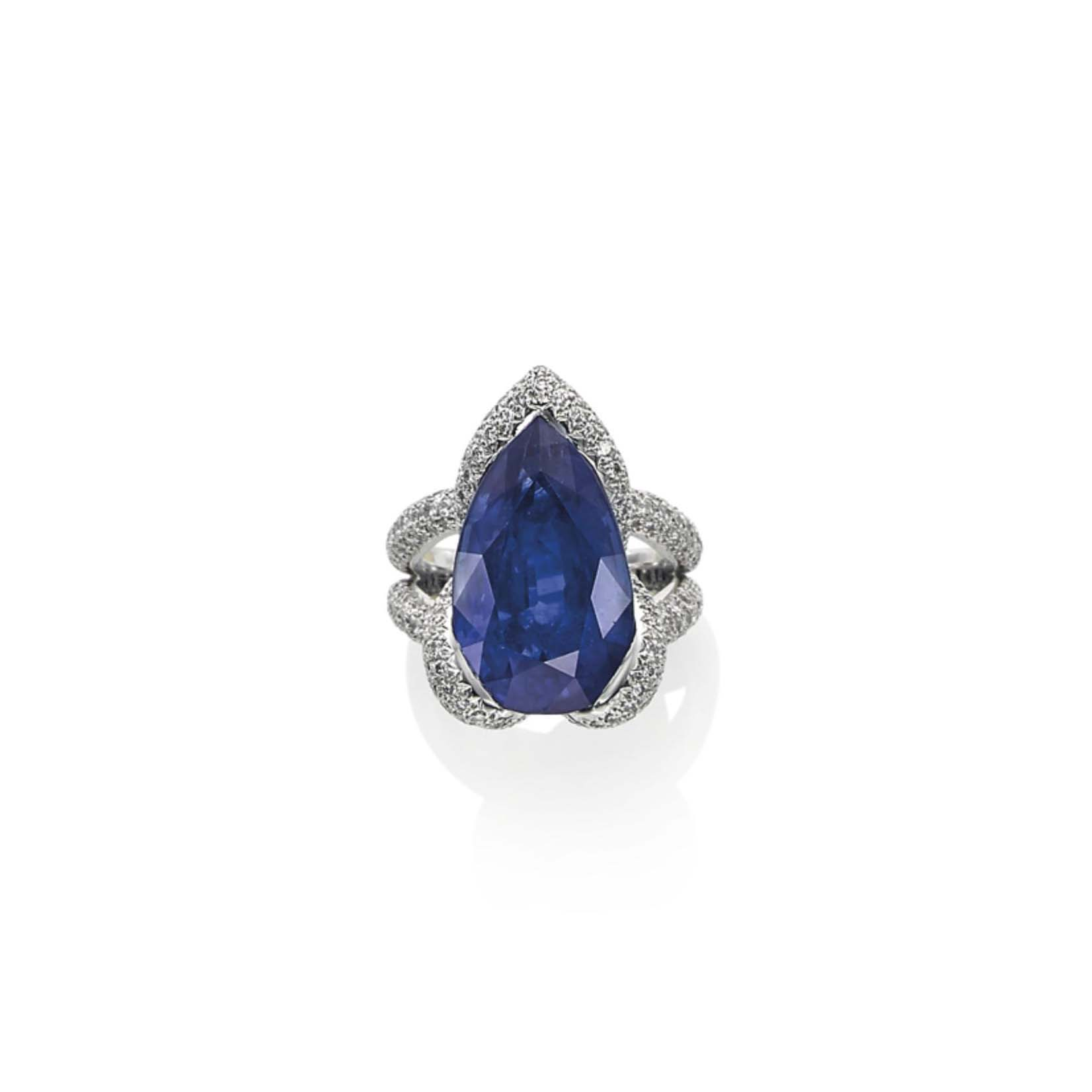 A SAPPHIRE AND DIAMOND 'SWAN' RING, BY MAUBOUSSIN