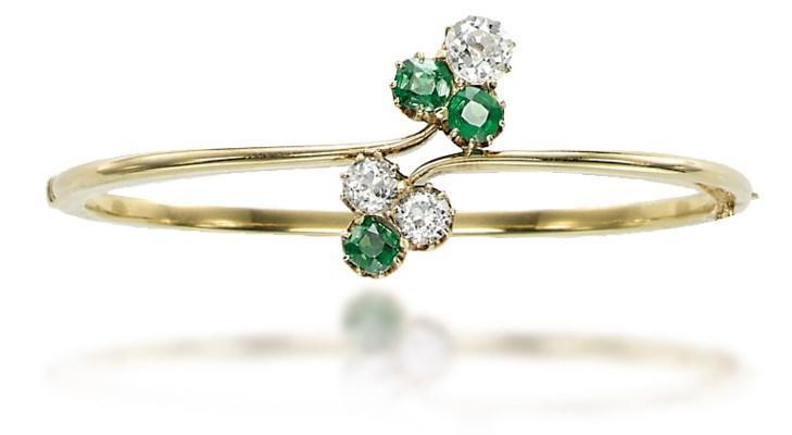 A GARNET, DIAMOND AND GOLD BAN