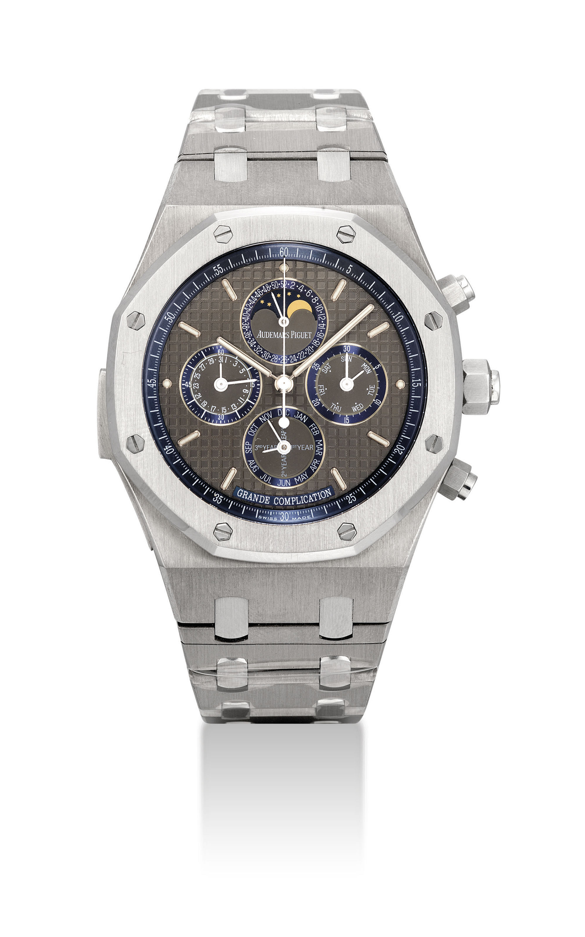 AUDEMARS PIGUET. AN EXTREMELY RARE AND IMPRESSIVE TITANIUM AUTOMATIC MINUTE REPEATING PERPETUAL CALENDAR SPLIT SECONDS CHRONOGRAPH WRISTWATCH WITH WEEK AND LEAP YEAR INDICATION AND MOON PHASES