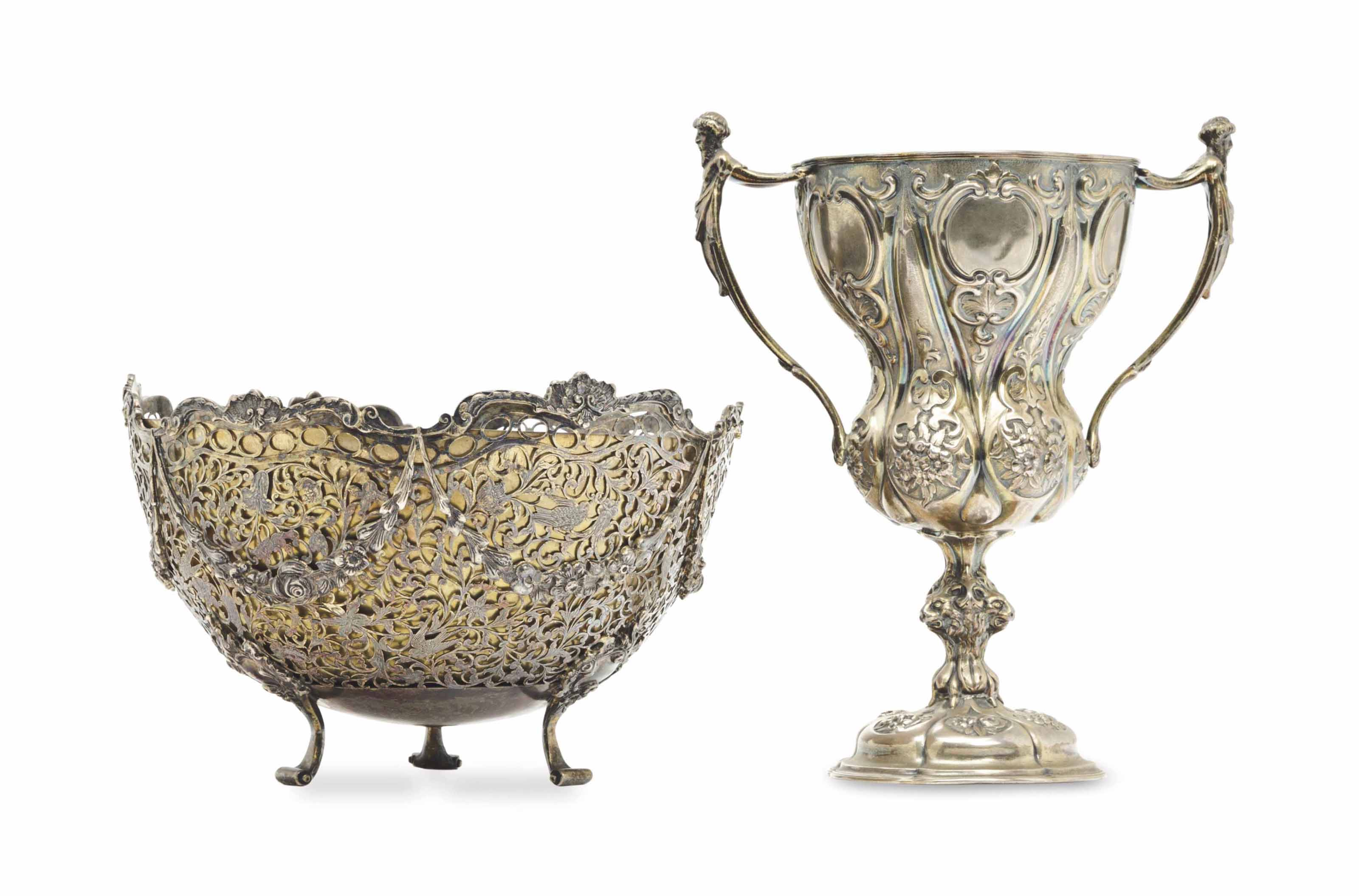 A VICTORIAN SILVER-GILT TWO-HANDLED CUP, AND AN EDWARD VII SILVER-GILT RETICULATED BOWL,