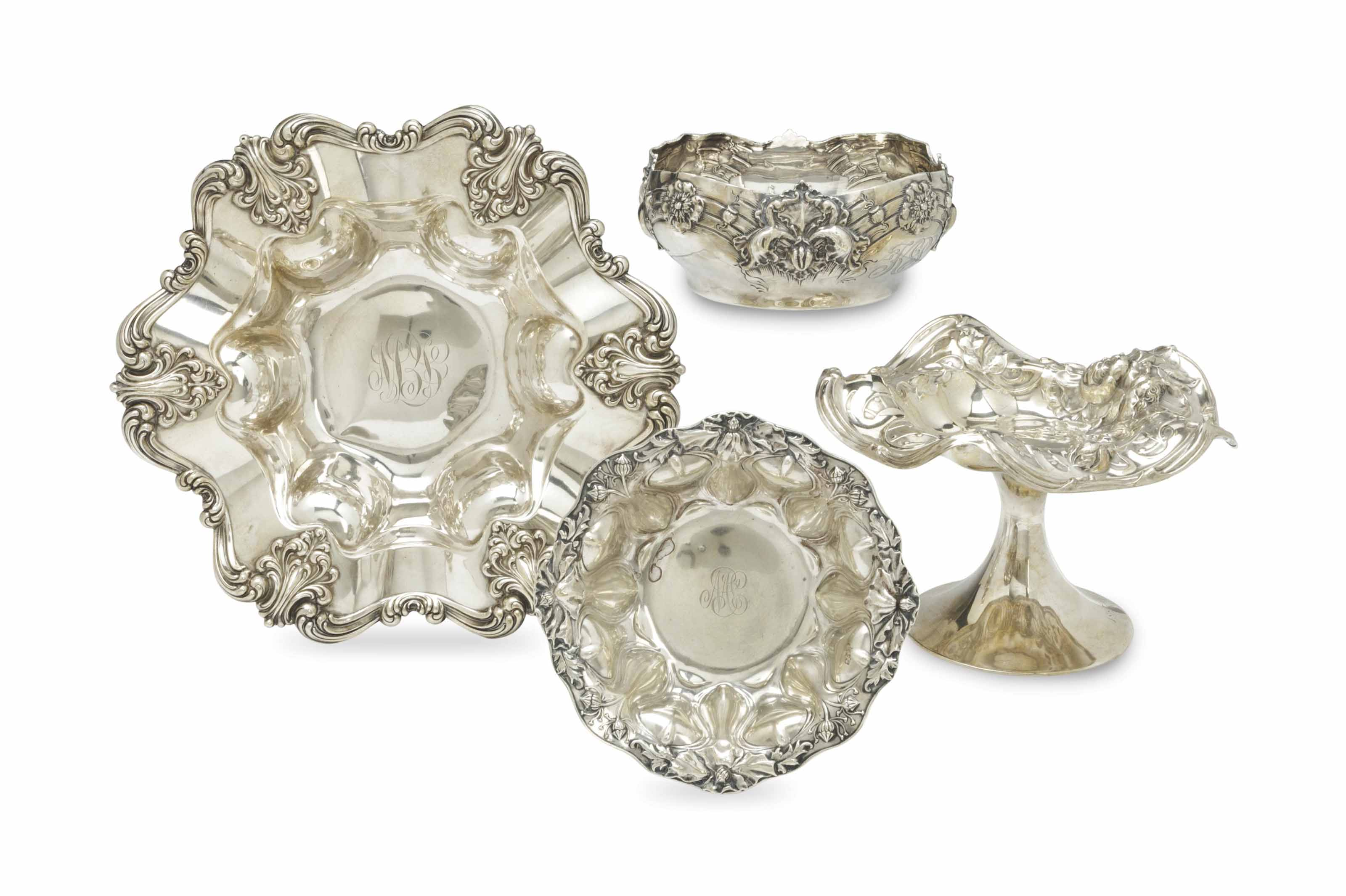 FOUR AMERICAN REPOUSSE SILVER SERVING WARES,