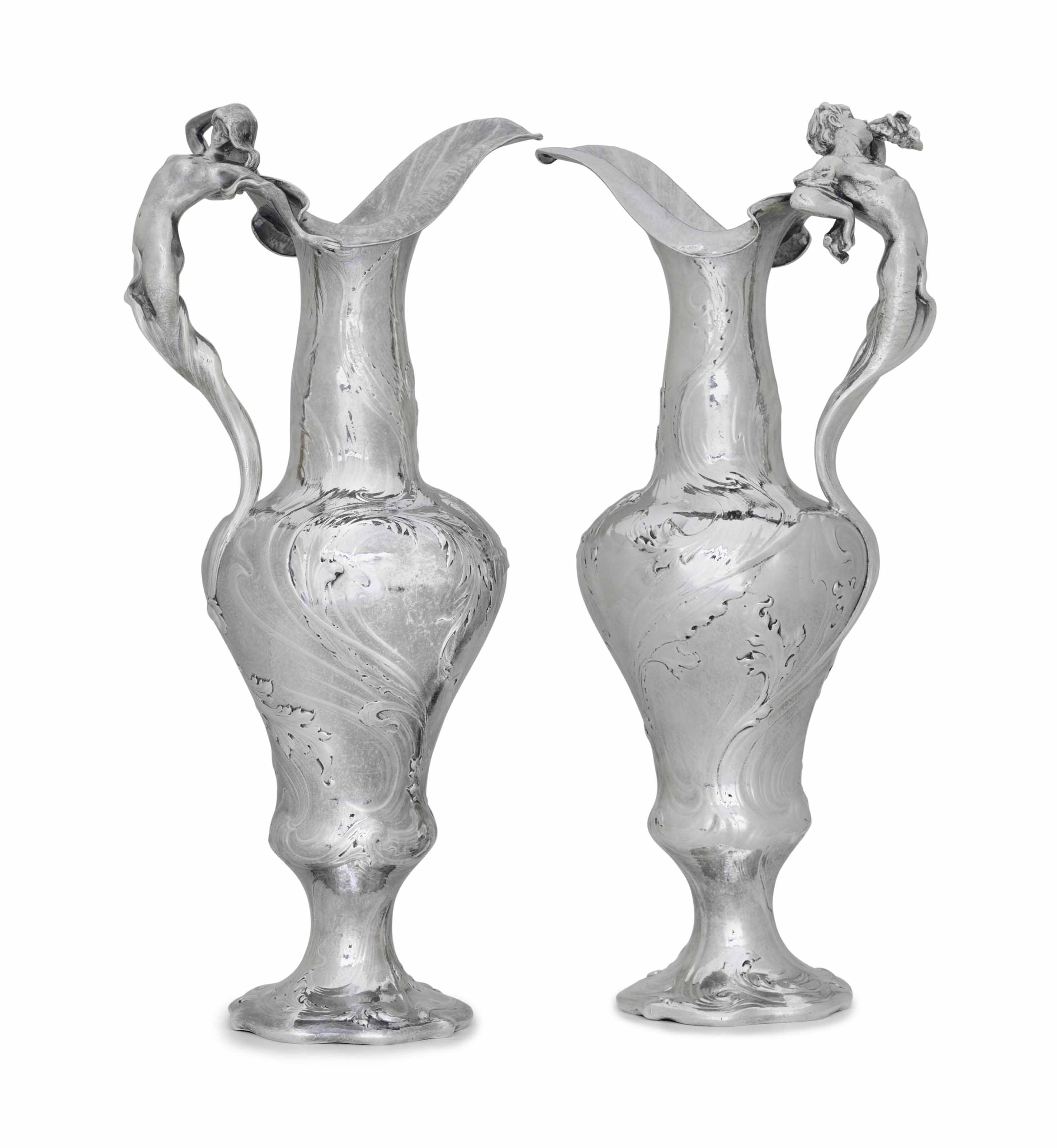 AN IMPORTANT PAIR OF MARTELE SILVER FIGURAL EWERS