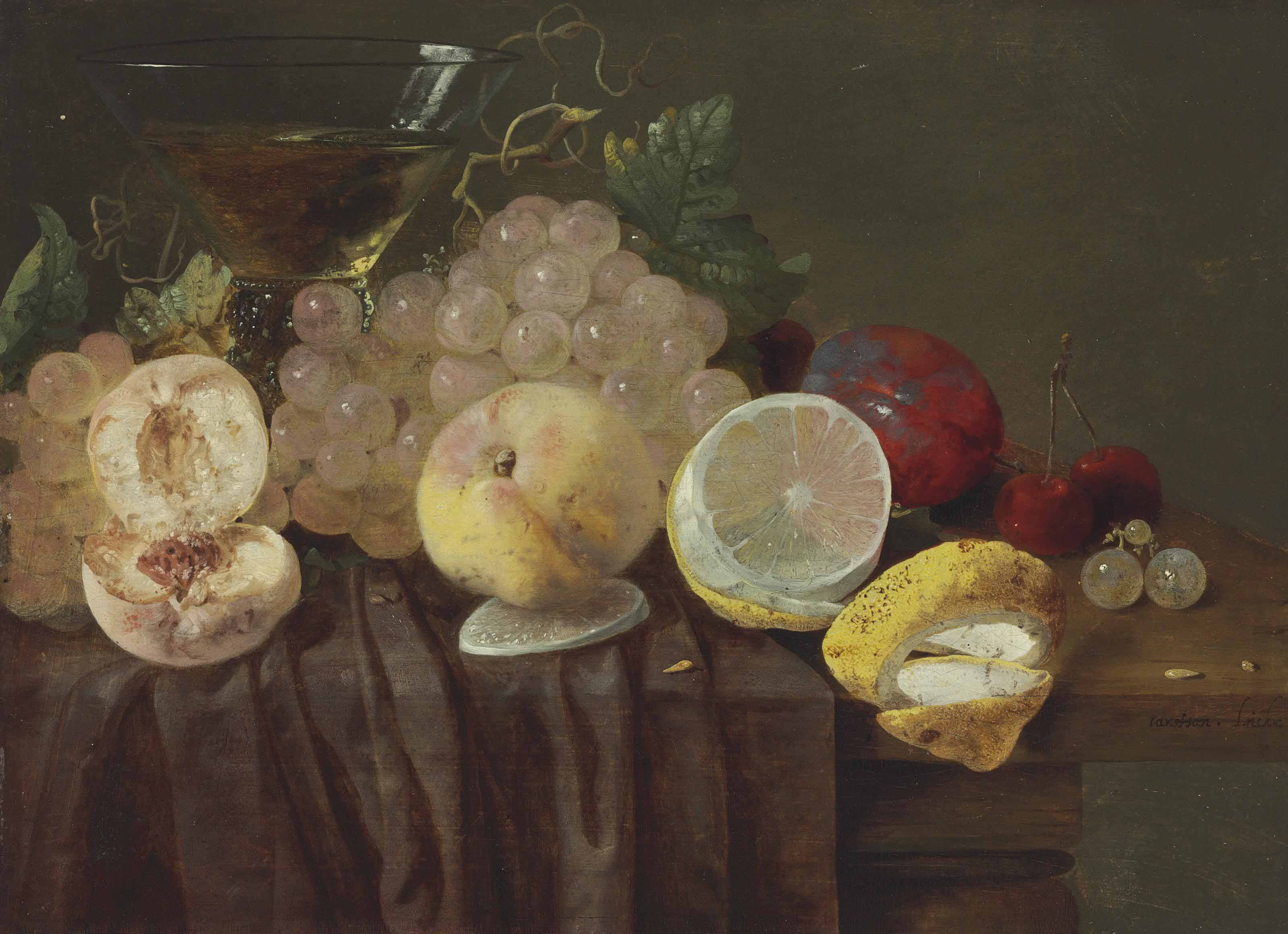 Grapes, peaches, a lemon, plums, cherries and a roemer on a partially-draped table