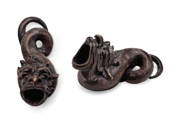 A BRONZE INKWELL IN THE FORM O