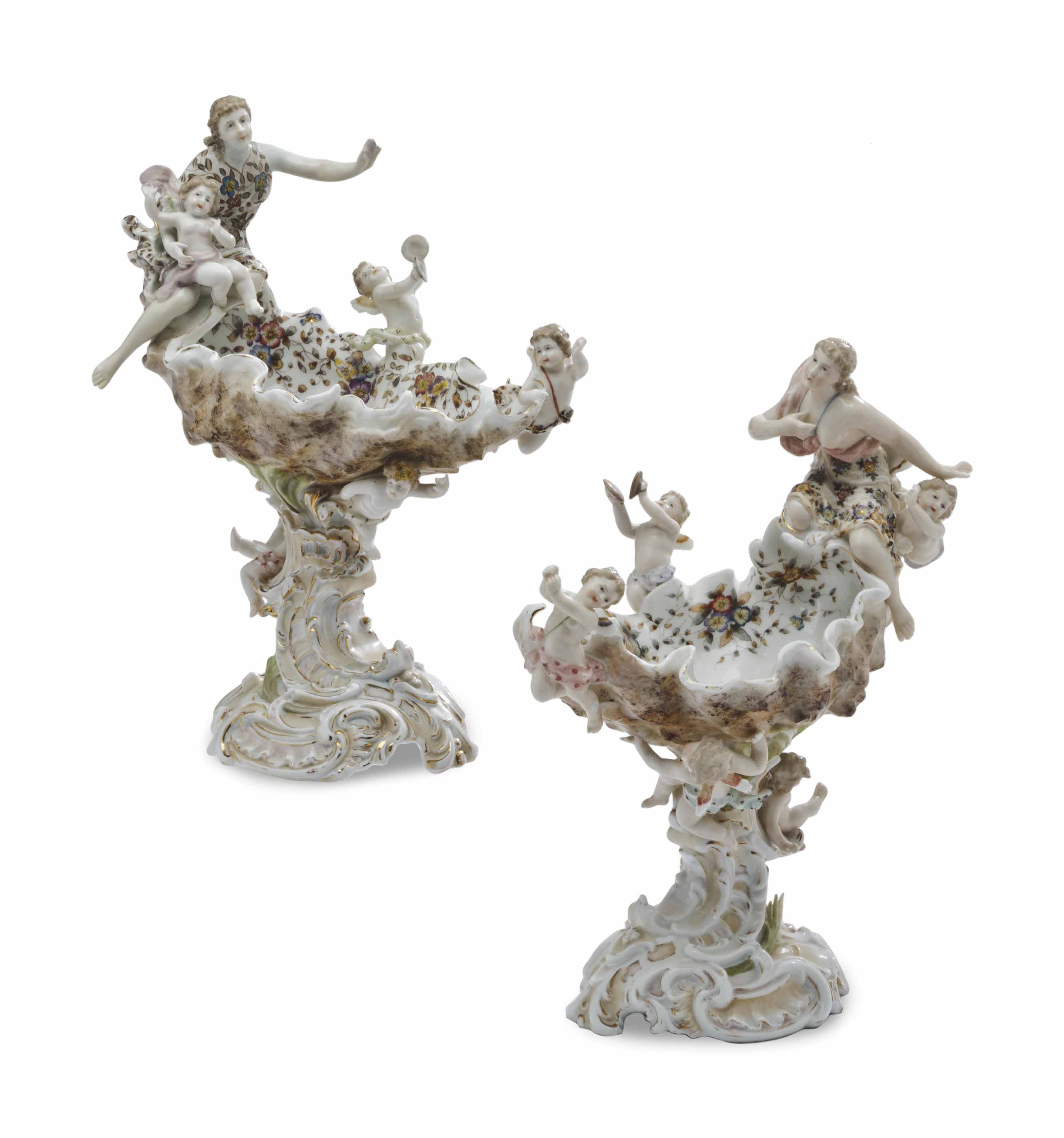 A PAIR OF GERMAN PORCELAIN SHELL-FORM FIGURAL SWEET MEAT DISHES,