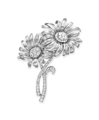A DIAMOND AND WHITE GOLD FLOWE