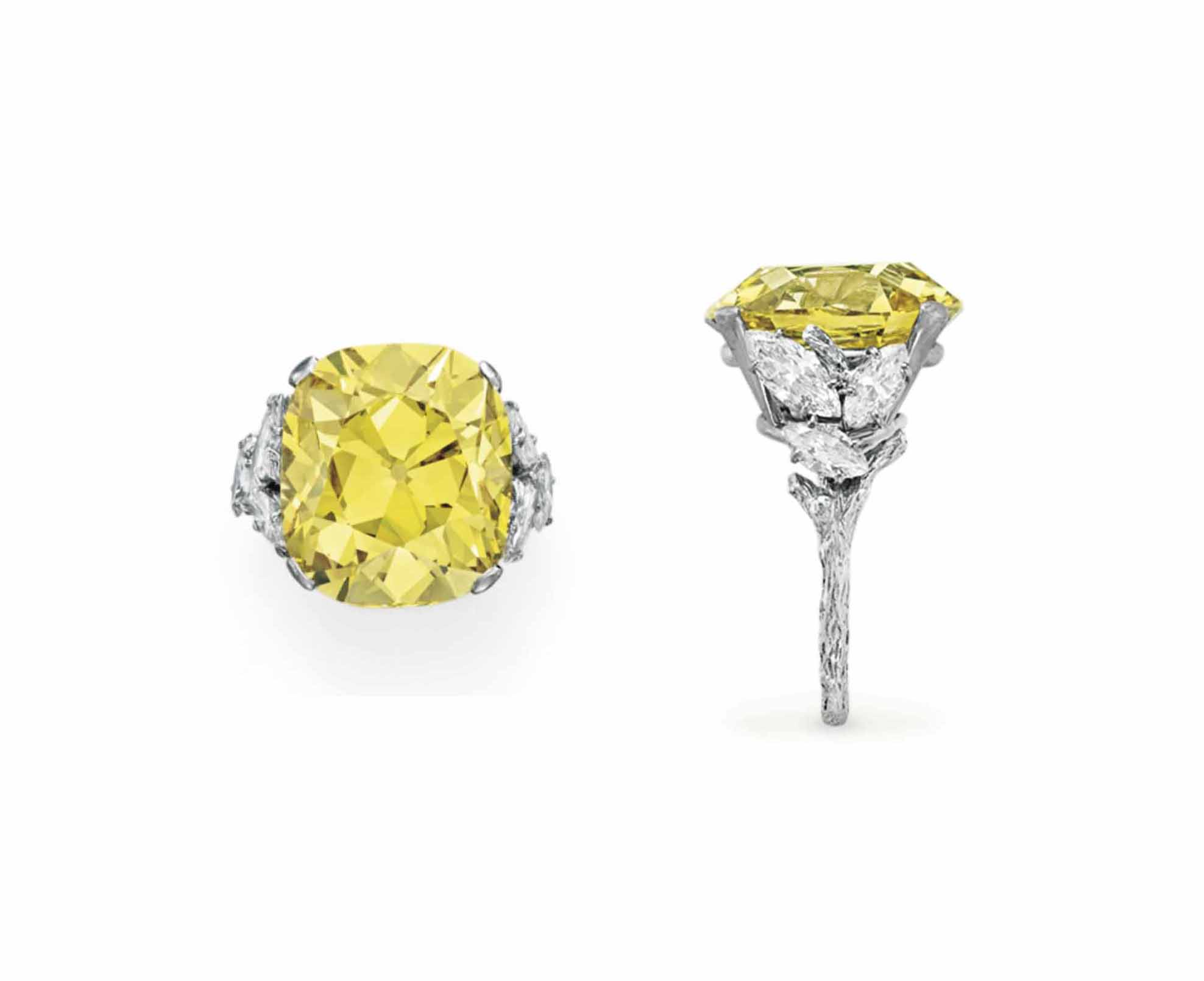 A TREATED COLORED DIAMOND AND DIAMOND RING, BY STERLÉ
