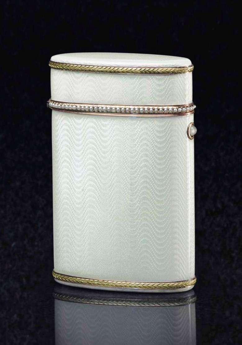 A gem-set gold-mounted, silver-gilt and guilloché enamel cigarette case, by Fabergé, with the workmasters mark of Henrik Wigström, St. Petersburg, 1908-1917, scratched inventory number 21854. 3½  in (9  cm) high. Sold for $32,500 on 20 May 2015  at Christie's in New York