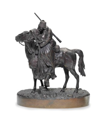 A BRONZE MODEL OF A SOLDIER ON