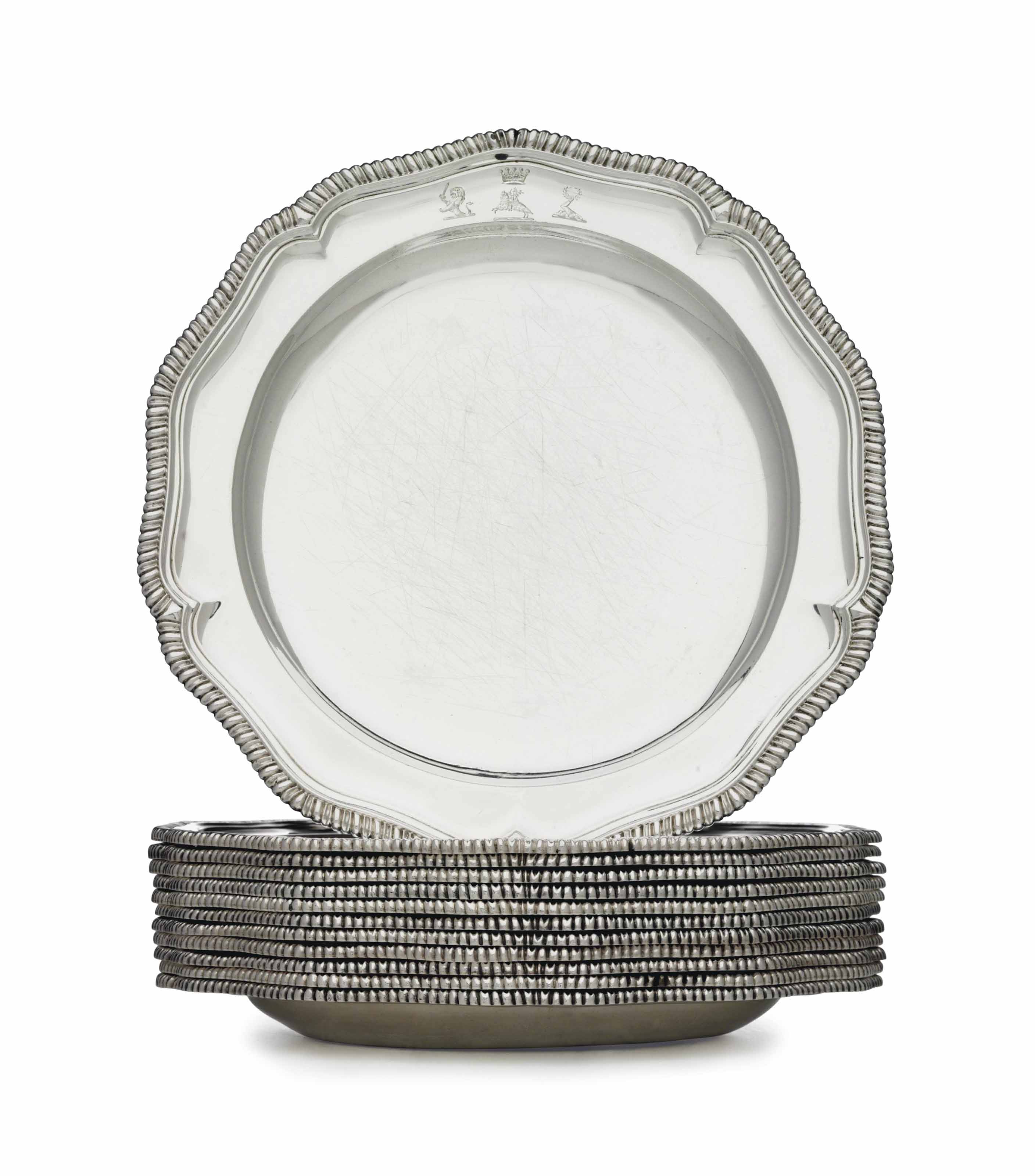 A SET OF TWELVE REGENCY SILVER DINNER PLATES