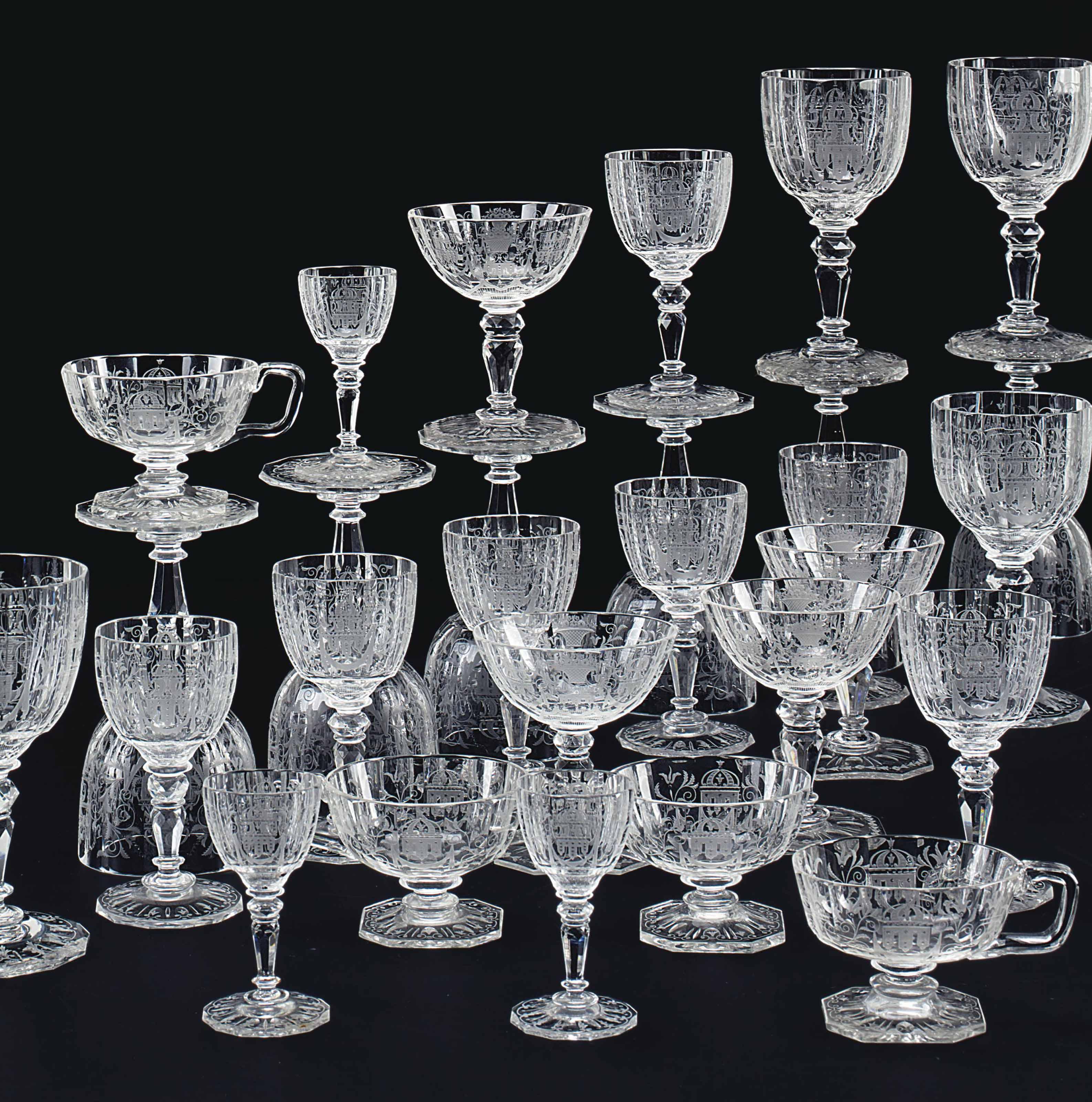 A LOBMEYR ENGRAVED GLASS PART STEMWARE SERVICE
