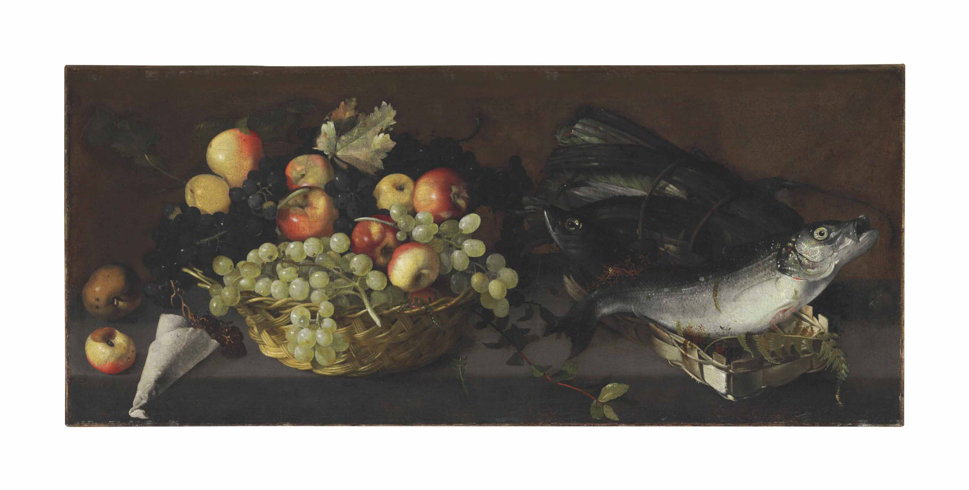 Apples and grapes in a basket with fish on a stone ledge