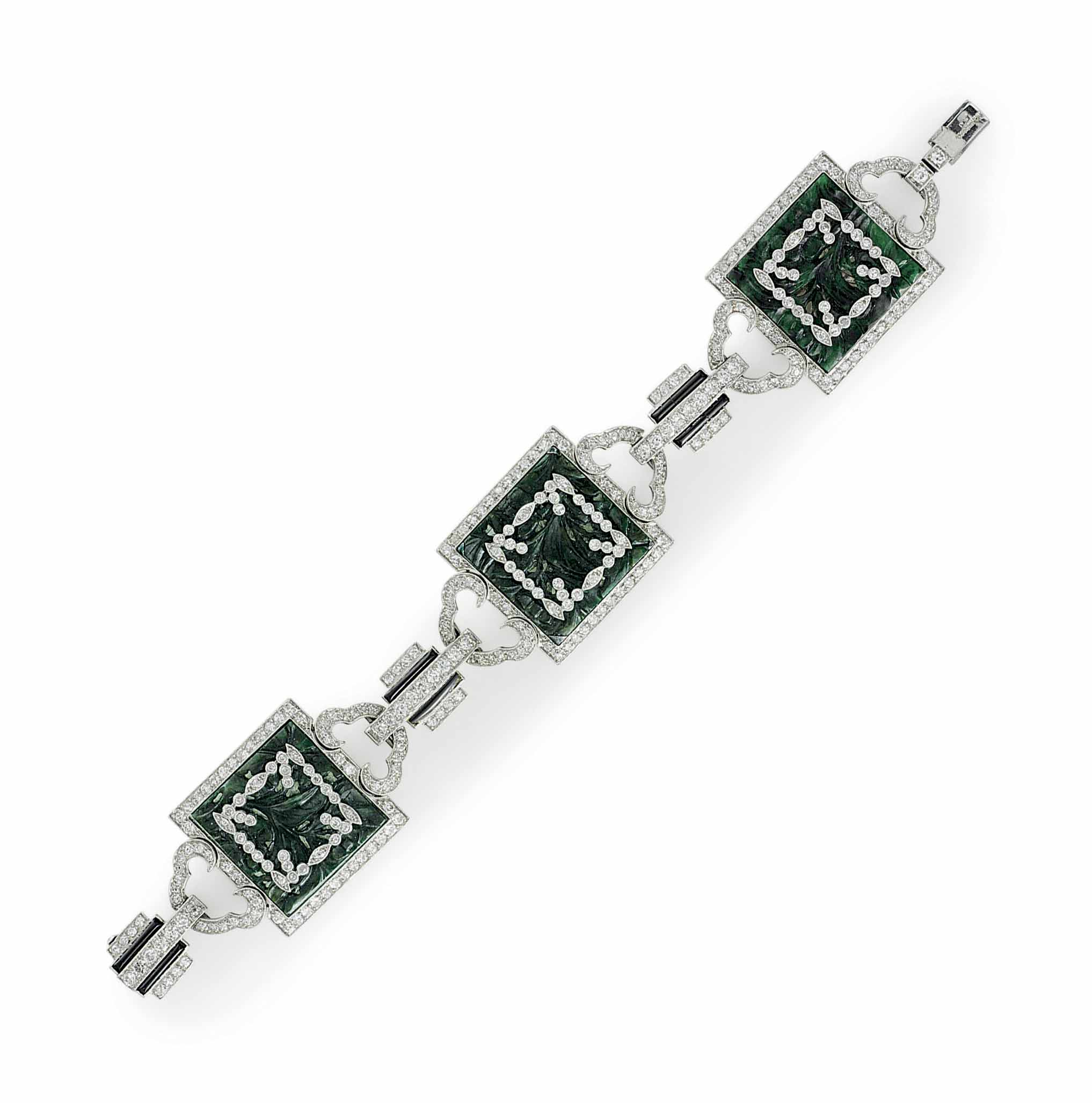AN ART DECO DIAMOND, JADE AND ONYX BRACELET, BY MARCUS & CO.