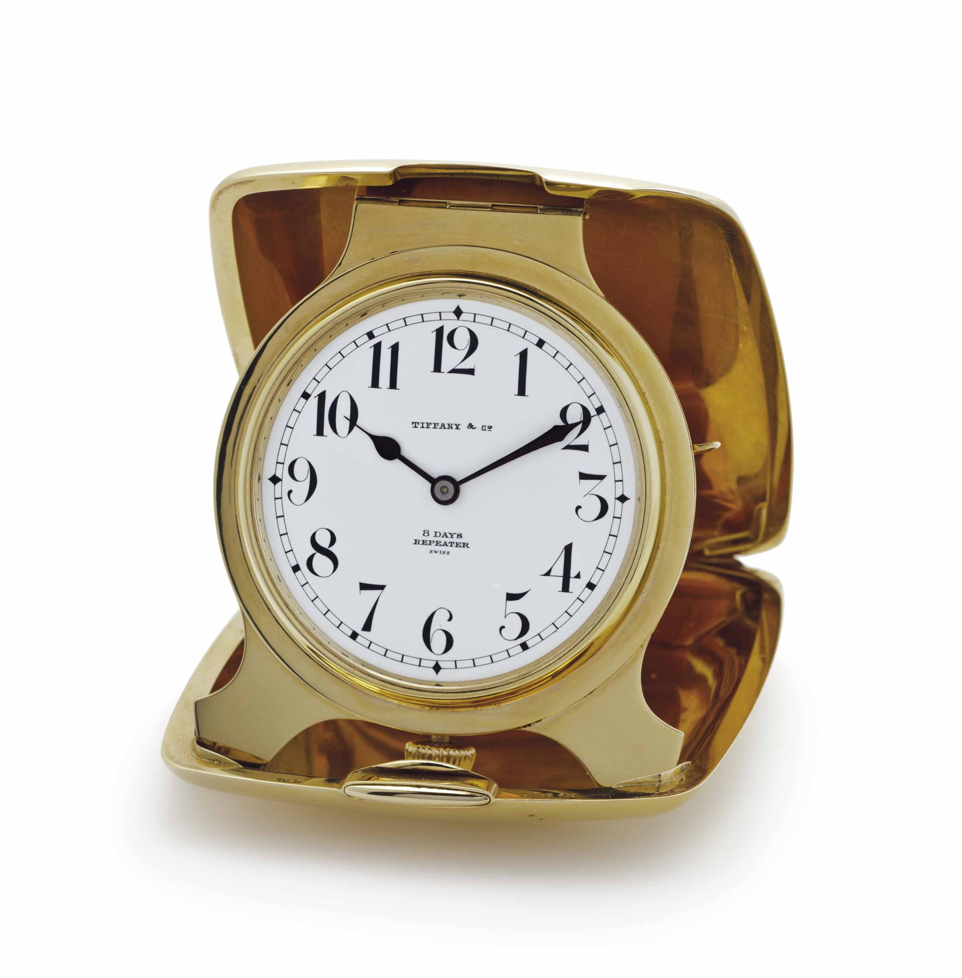 Tiffany and Wittnauer. An 18k Gold Quarter Repeating Folding Travel Clock with Presentation Box
