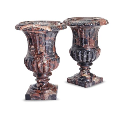 A PAIR OF CARVED MARBLE URNS,