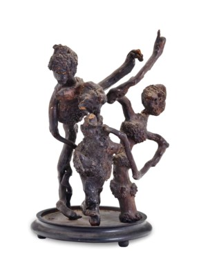 A ROOT AND WOOD CARVED FIGURAL
