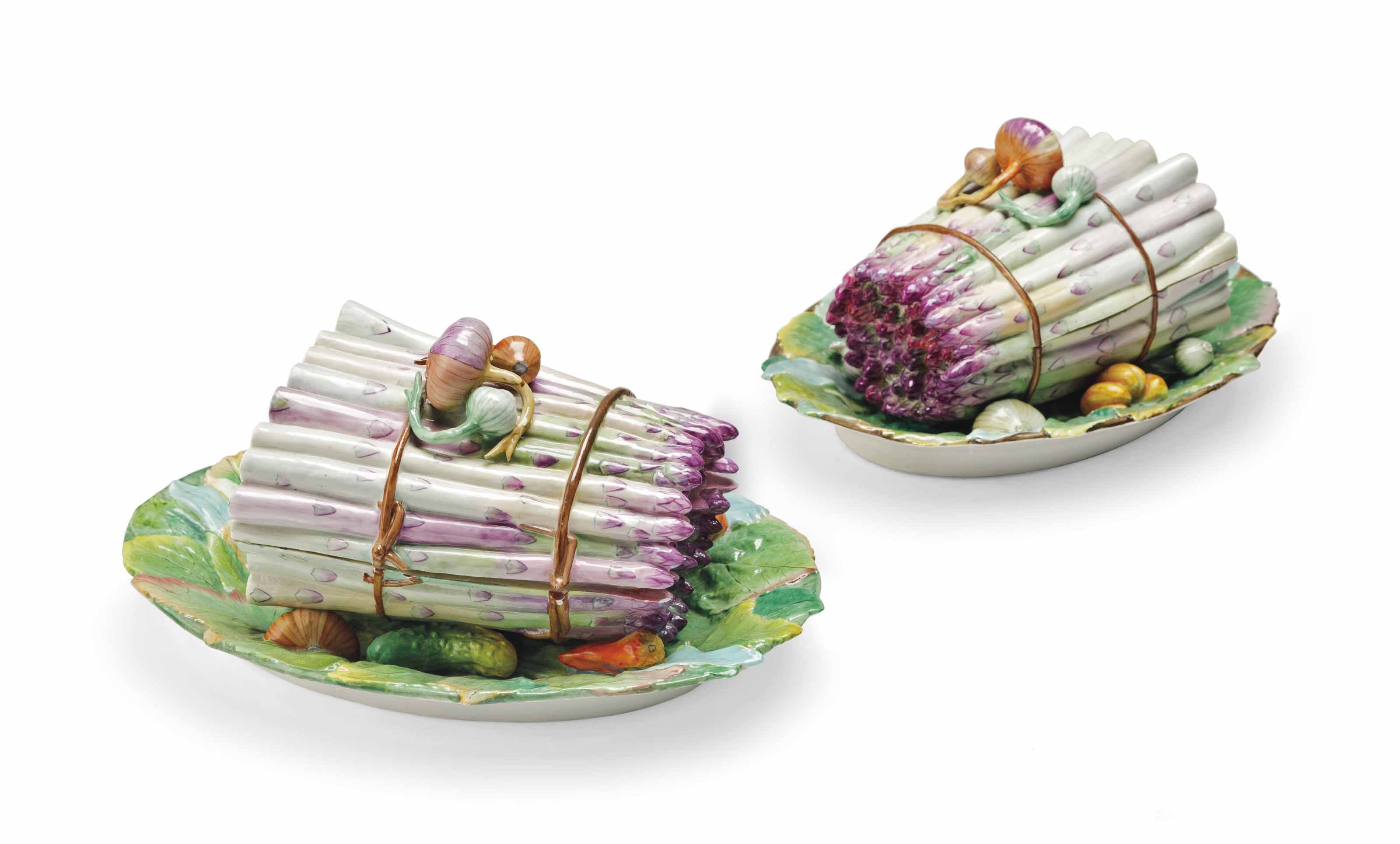 A PAIR OF JACOB PETIT PORCELAIN ASPARAGUS TUREENS AND COVERS ON FIXED STANDS