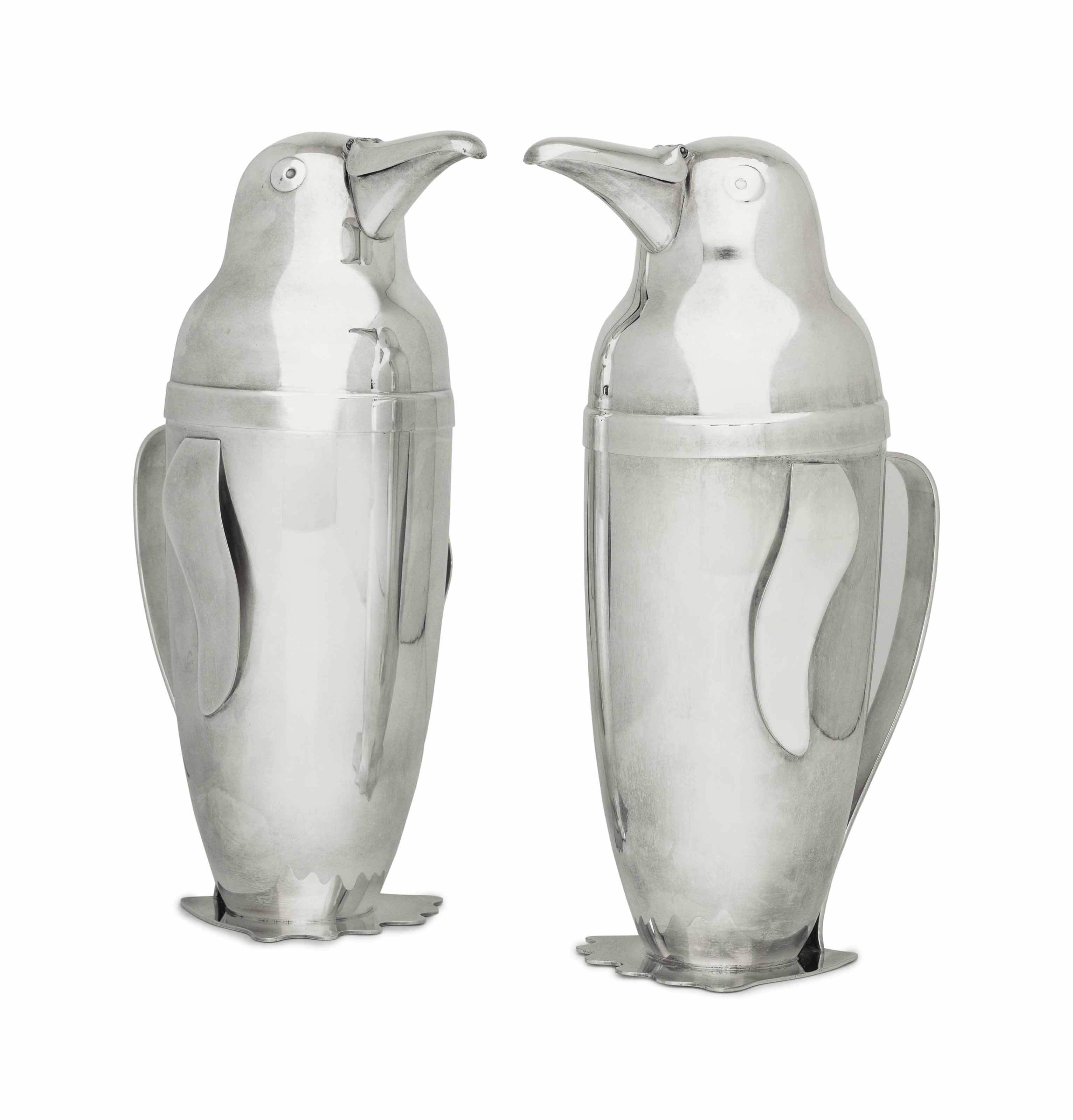 A PAIR OF AMERICAN SILVER PLATE PENGUIN-FORM COCKTAIL SHAKERS