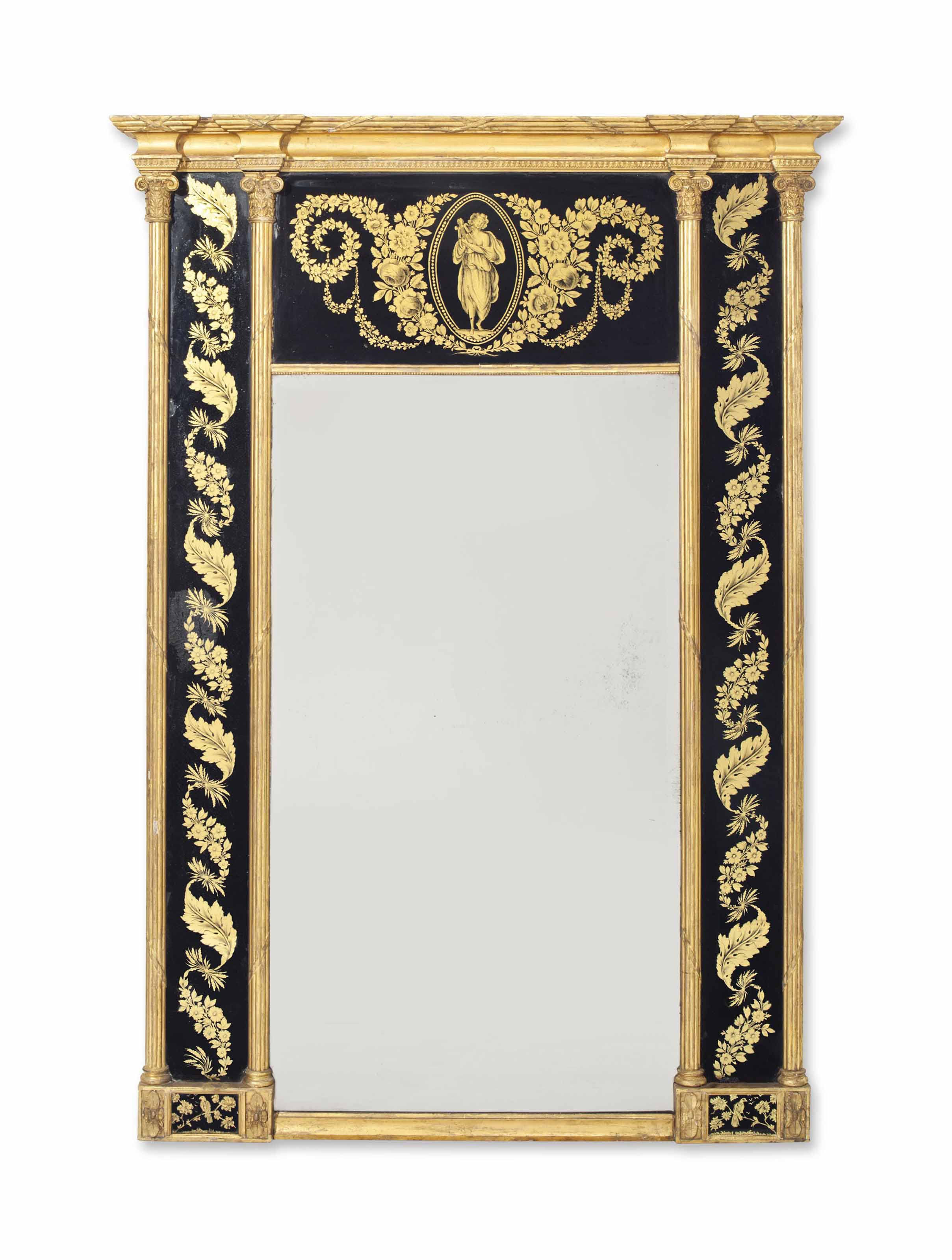 A REGENCY GILTWOOD GILT-COMPOSITION AND VERRE EGLOMISE MIRROR
