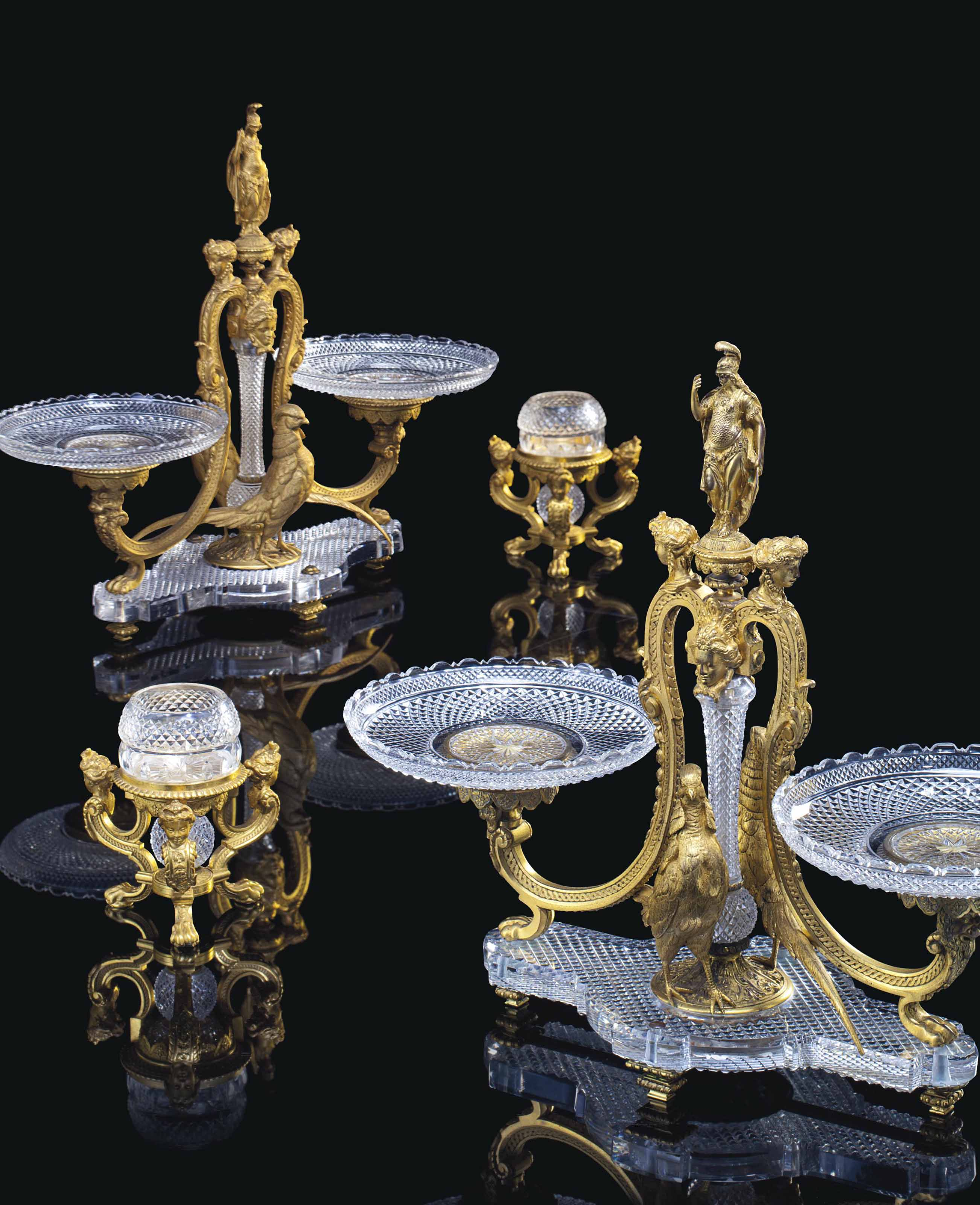 A FRENCH ORMOLU AND CUT-CRYSTAL FOUR-PIECE TABLE GARNITURE