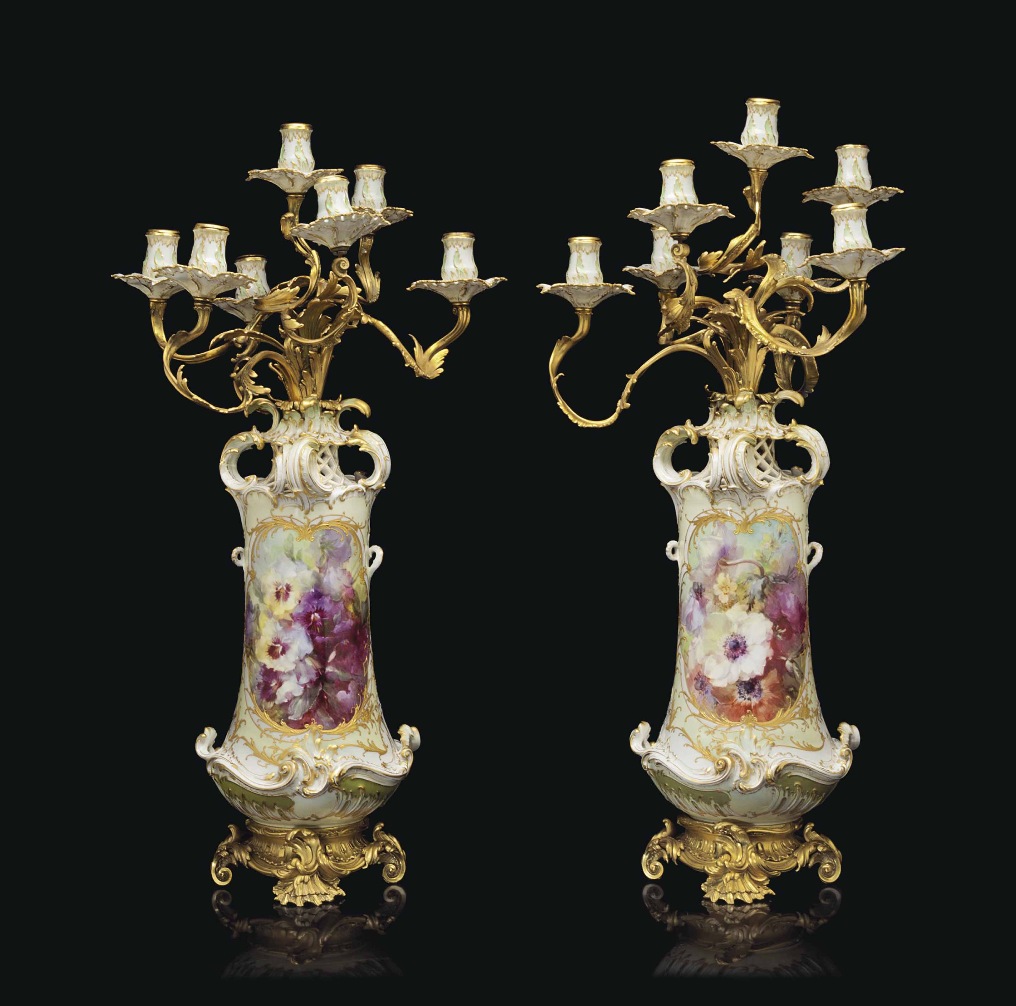 A PAIR OF ORMOLU-MOUNTED BERLIN PORCELAIN PALE-YELLOW GROUND SEVEN-LIGHT CANDELABRA