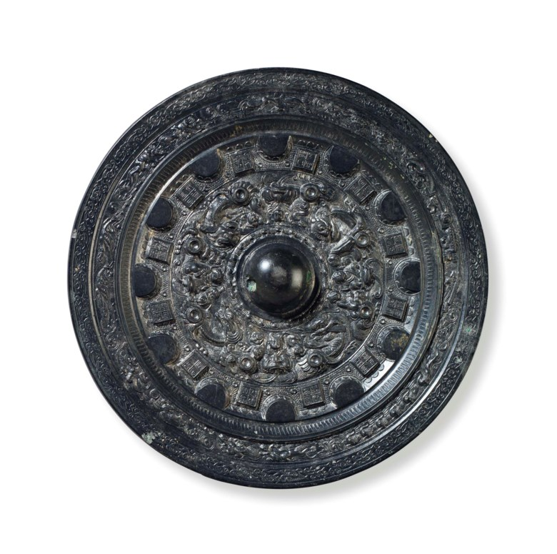 A bronze circular mirror with deities and animals, China, mid-late Eastern Han dynasty, late 2nd-3rd century AD. 5½  in (14  cm) diameter, box. Sold for $37,500 on 20 March 2015  at Christie's in New York