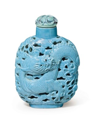 A TURQUOISE-ENAMELED RETICULAT