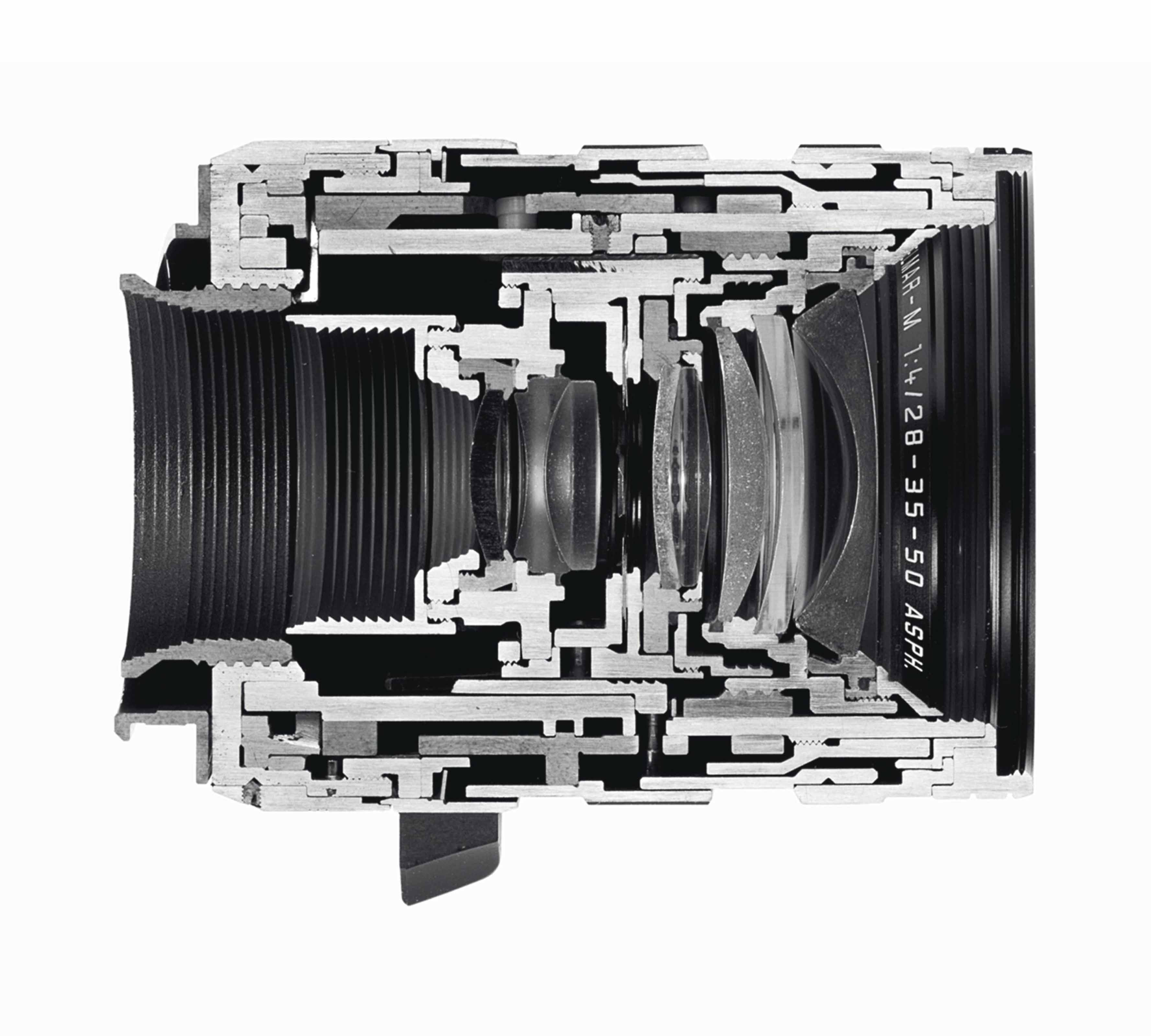 Cutaway of a LEICA TRI-ELMAR-M 28-35-50 mm f/4 ASPH. Angle of view: Focal lenght 28 mm: 75°, 65°, 46° Focal length 35 mm: 63°, 54°, 38° Focal length 50 mm: 47°, 40°, 27° Optical design: 8 elements in 6 Aperture: f/4 (largest) f/22 (smallest) Scale: combined meter/feet-increments Leica M quick-change bayonet Focusing range: 1m to Infinity Smallest object field: Focal length 28 mm: 750 x 1130 mm Focal length 35 mm: 620 x 930 mm Focal length 50 mm: 430 x 650 mm Highest reproduction ratio: Focal length 28 mm: 1:31 Focal length 35 mm: 1:26 Focal length 50 mm: 1:18 Lens produced between: 1998 and 2007 Date of the cut: unknown Fotostudio Axel Gnad, Düsseldorf, February 13, 2009