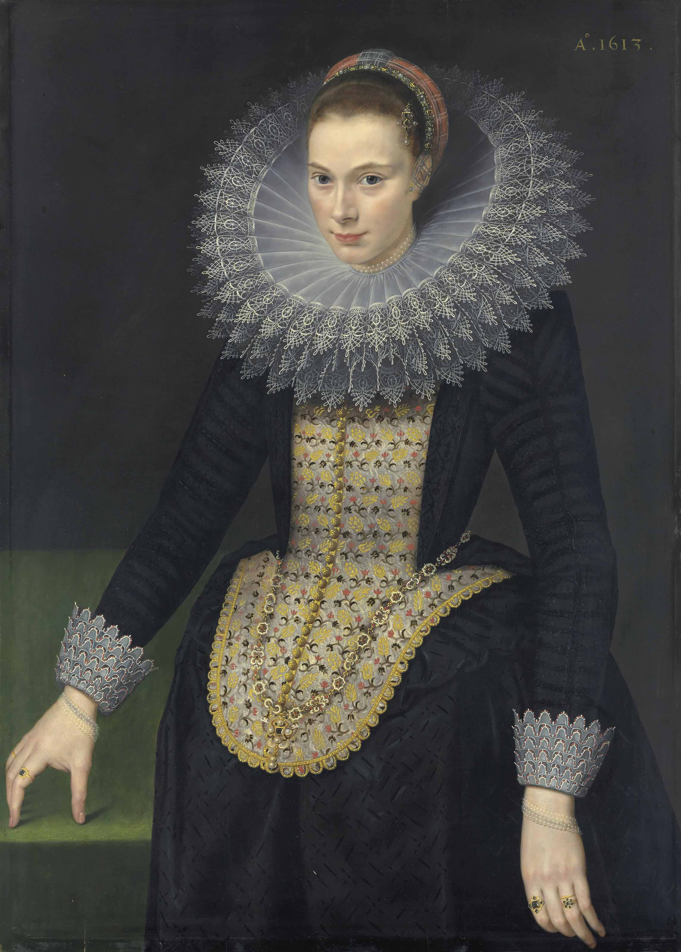 Portrait of a lady, three-quarter-length, in a black vlieger brocade gown, with an elongated embroidered stomacher, lace-trimmed cuffs and a cartwheel ruff trimmed with reticella lace