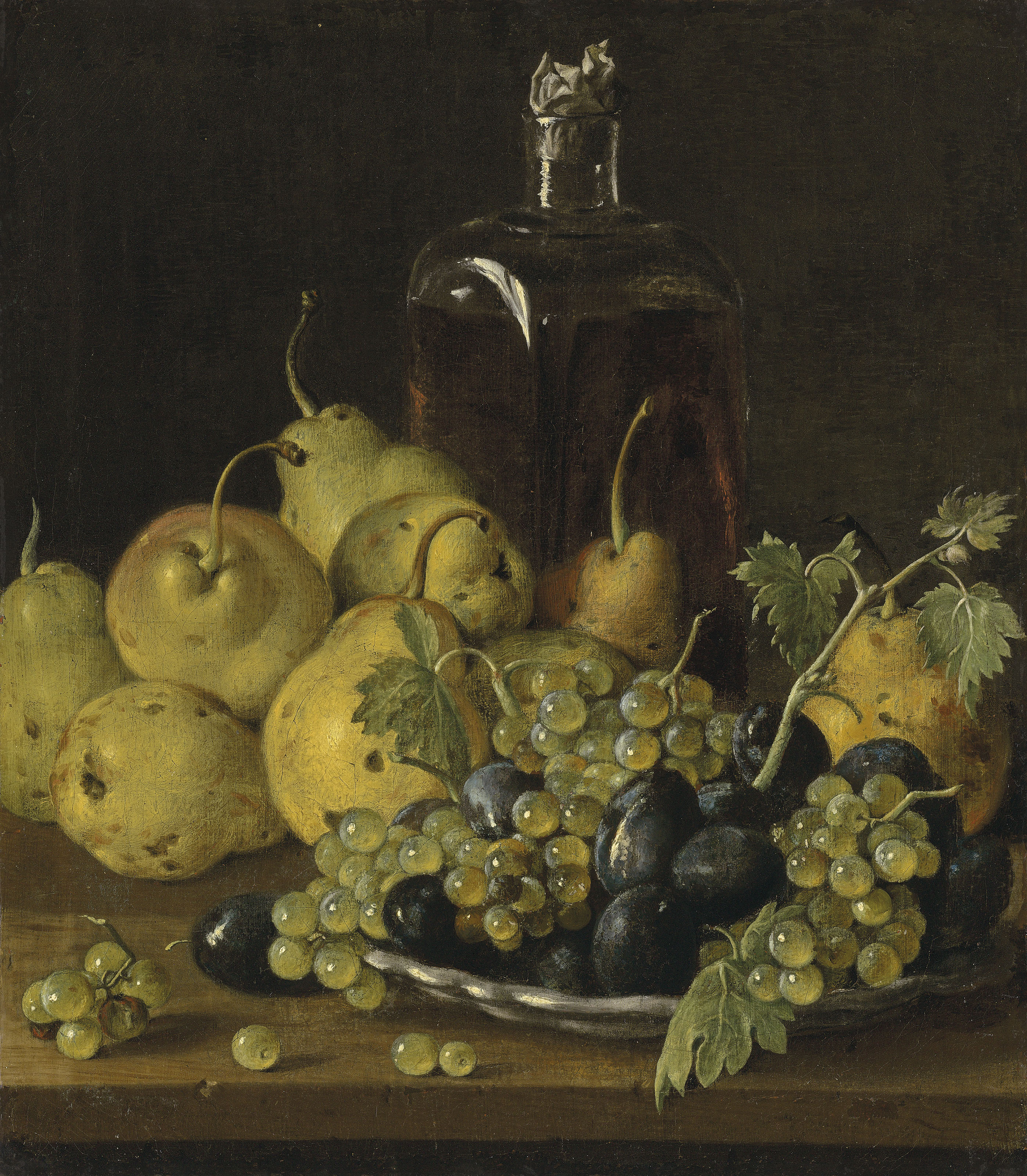 Grapes and plums on a plate, with pears and a glass bottle on a wooden ledge
