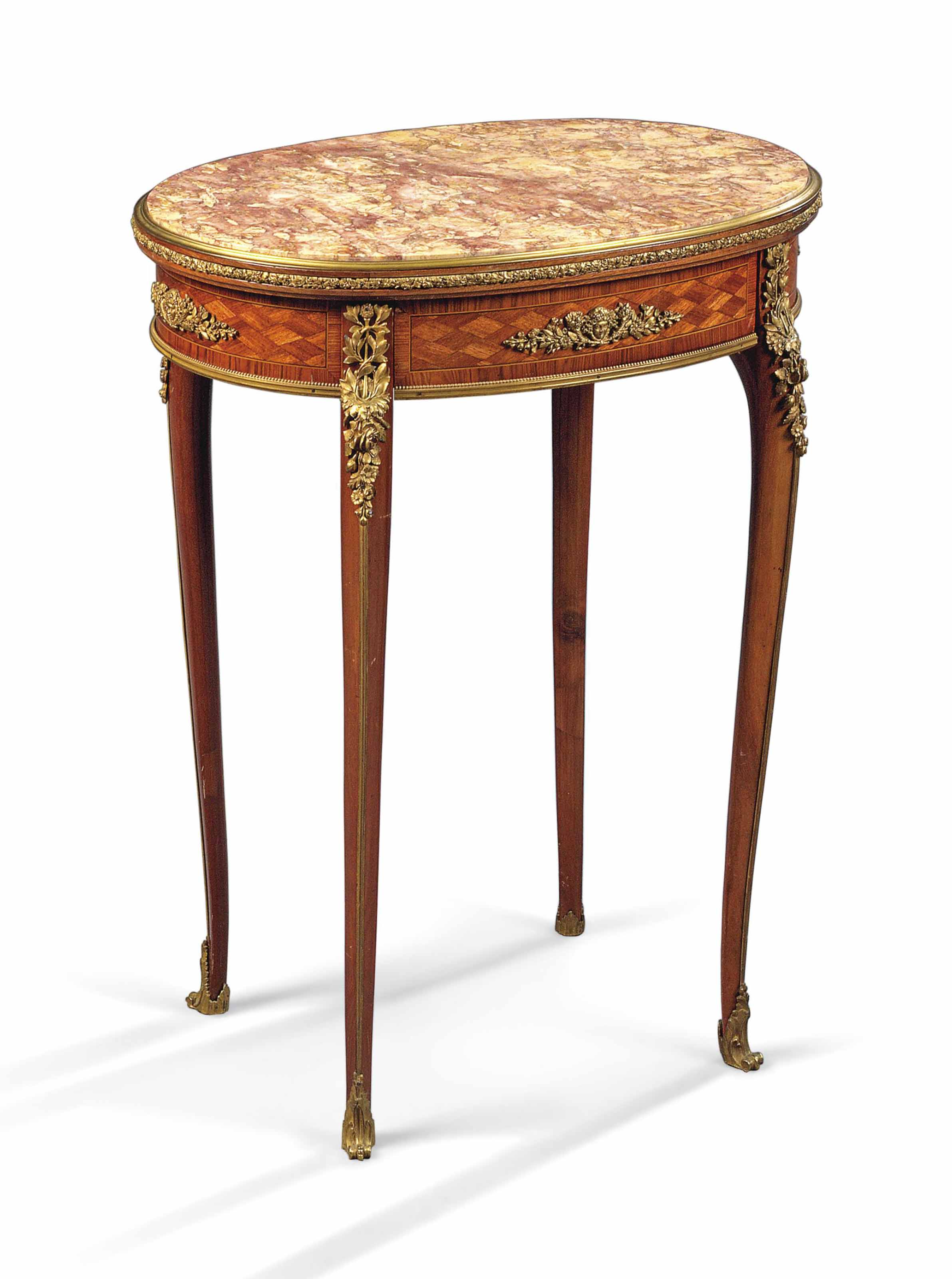 A FRENCH ORMOLU-MOUNTED MAHOGANY, TULIPWOOD AND BOIS SATINE GUERIDON