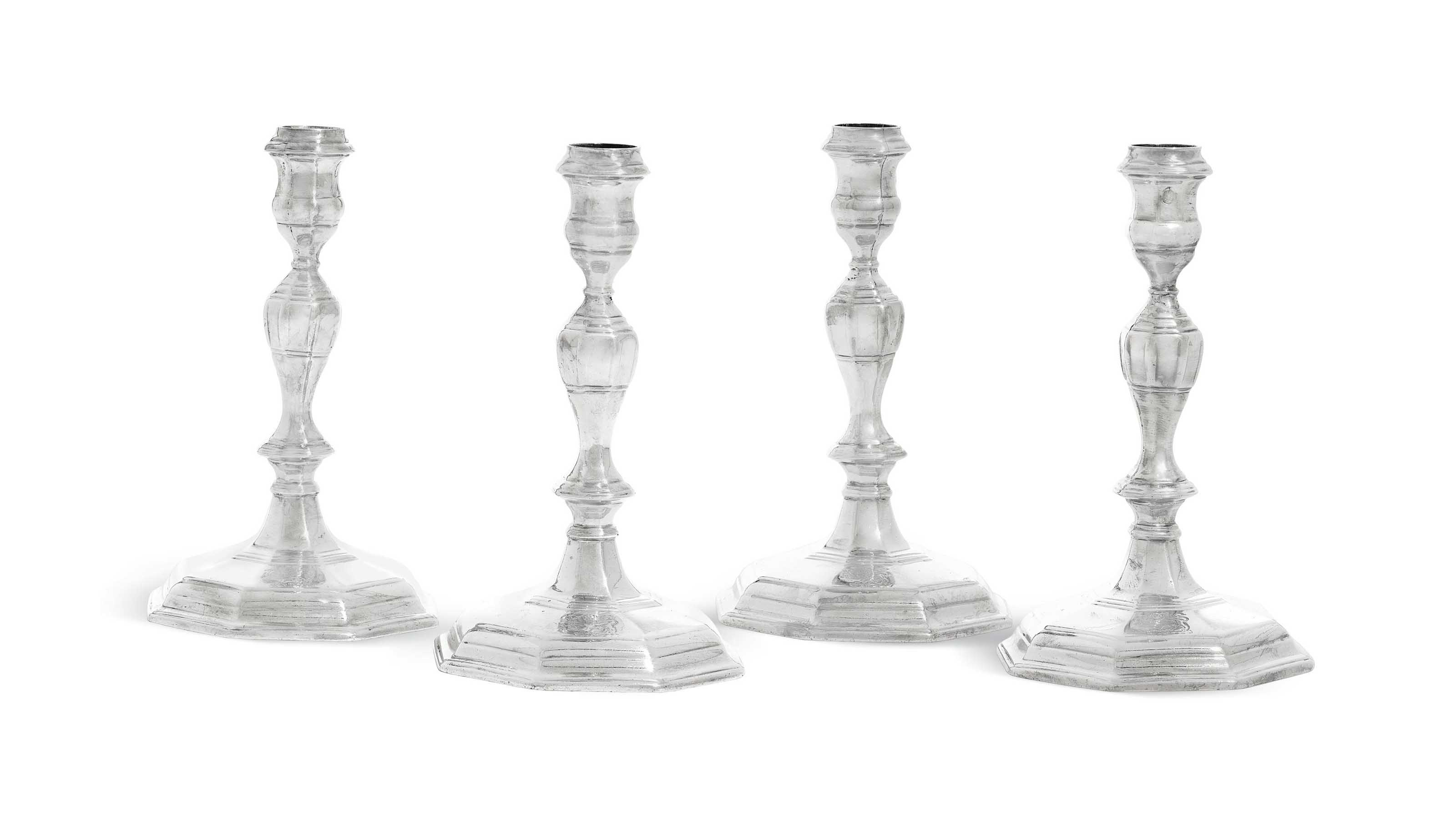 A SET OF FOUR QUEEN ANNE SILVER CANDLESTICKS